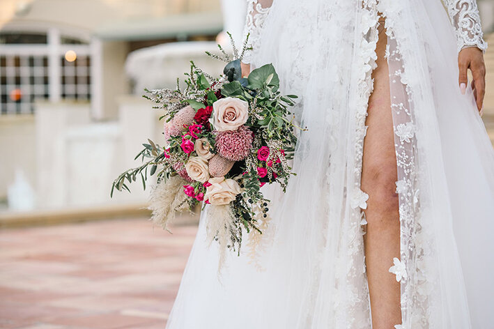 bespoke-bridal-designer-helena-couture-designs-custom-wedding-dresses-gold-coast-brisbane-affordable-boho-2019-photoshoot-sanctuary-cove-intercontinental-flower-bouquet-legs.jpg