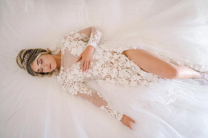 bespoke-bridal-designer-helena-couture-designs-custom-wedding-dresses-gold-coast-brisbane-affordable-boho-2019-photoshoot-sanctuary-cove-intercontinental-bride-lying-down.jpg