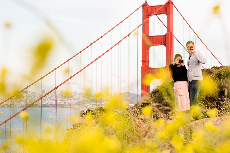 couple taking photo of photographer