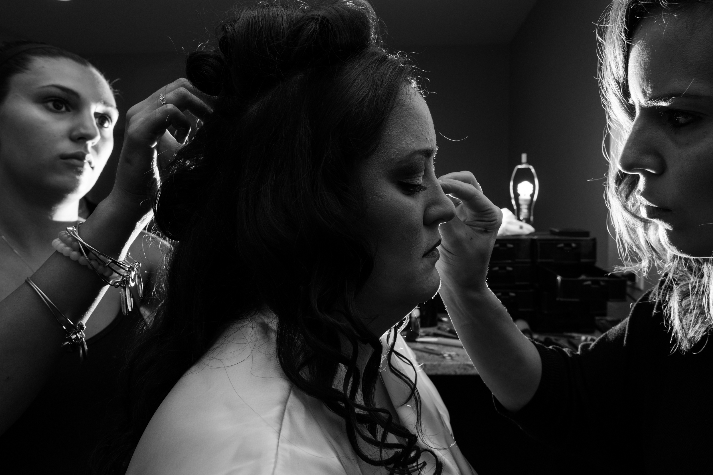 bride getting makeup and hair done