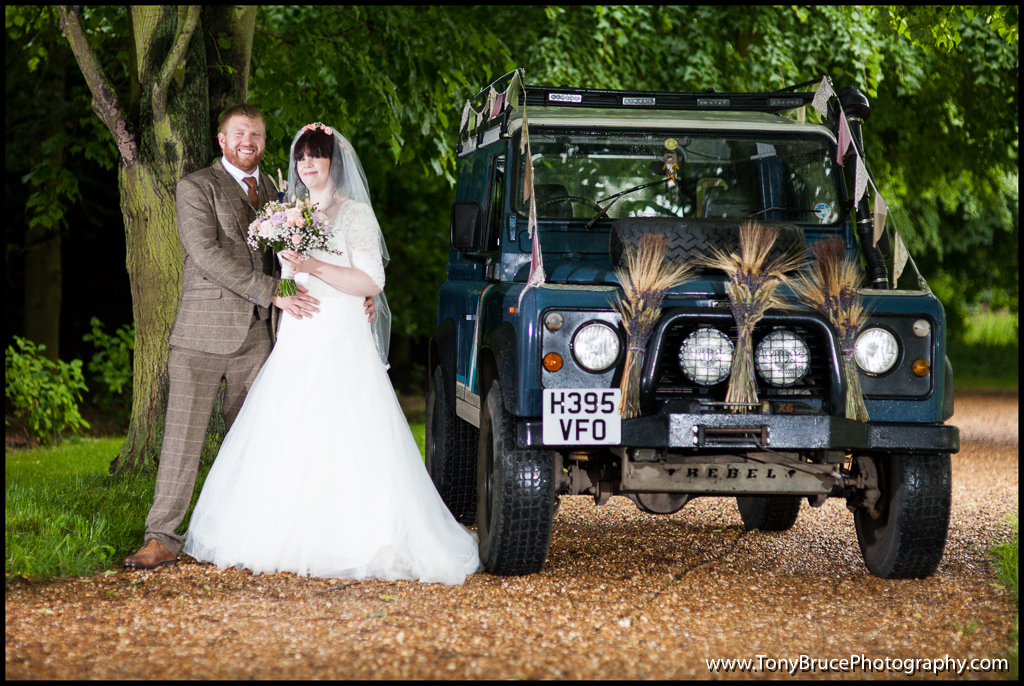 Dany and Laura next to his beloved Defender. My first attempt at day time off camera flash really helped to even out the exposure. Check out the decor on the car!
