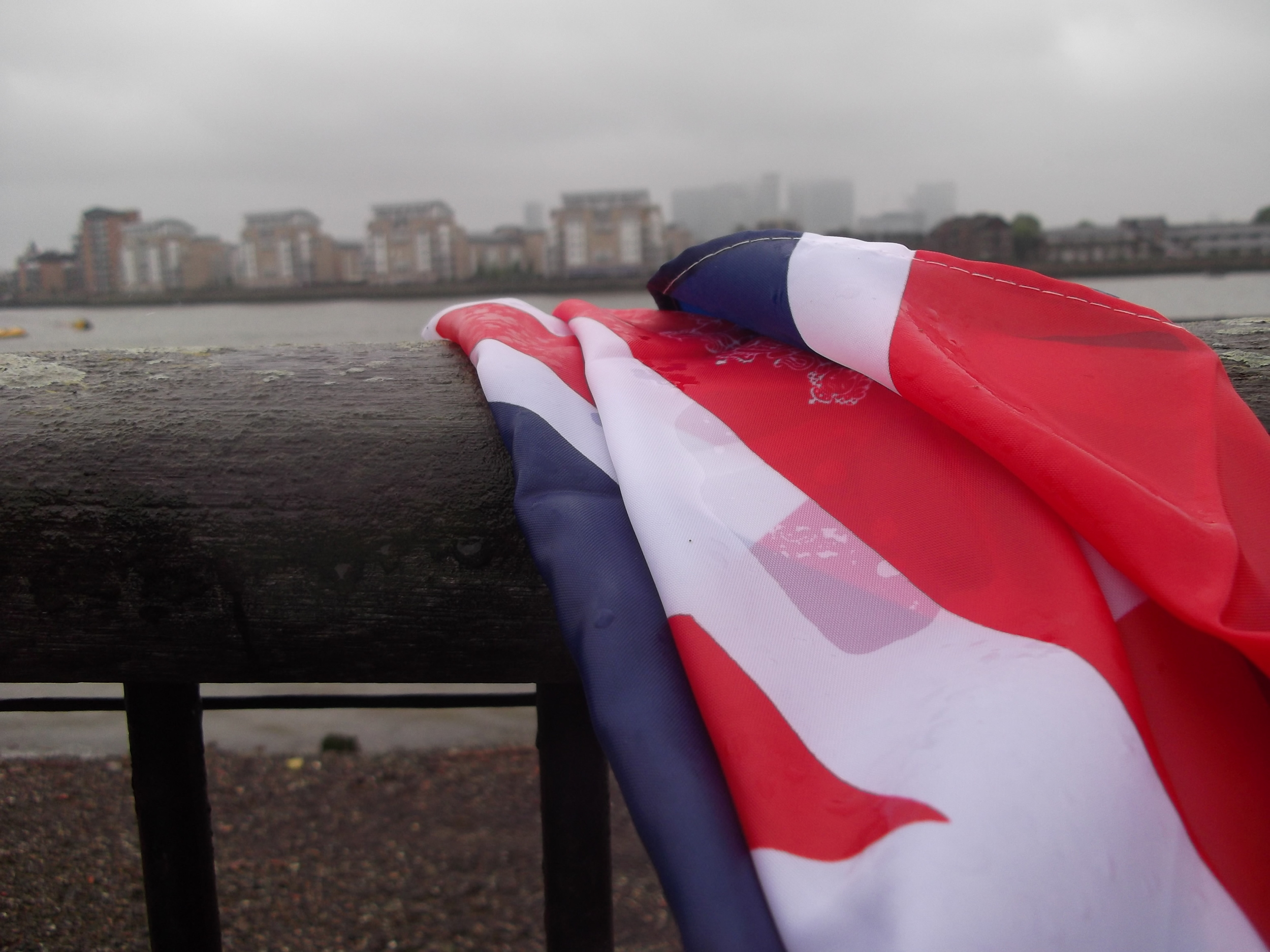Waving a damp flag on a grey day at the Queen's Diamond Jubilee, Greenwich, June 2012