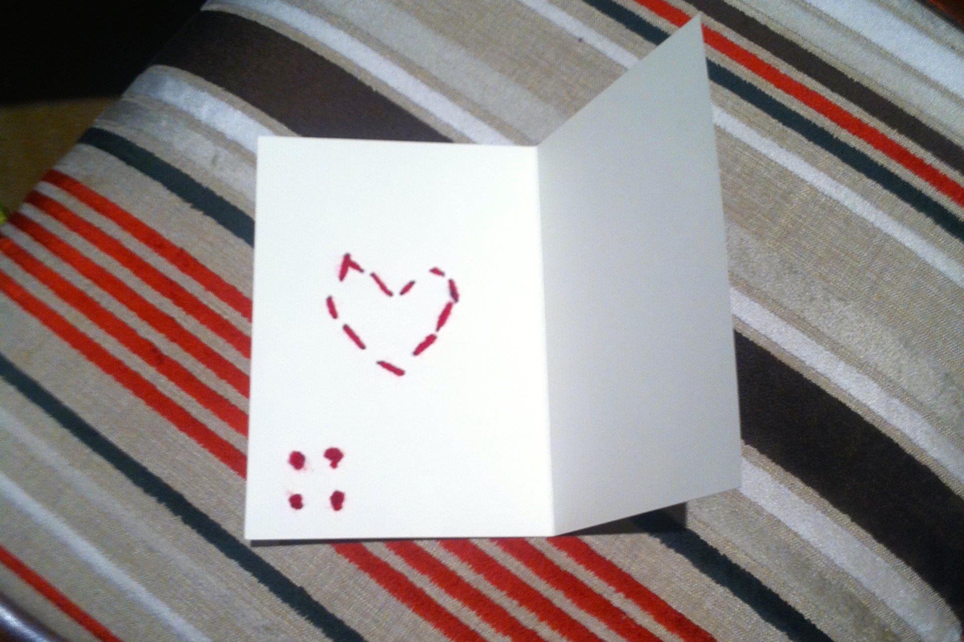I like the detail of the running stitch heart visible on the inside of the card