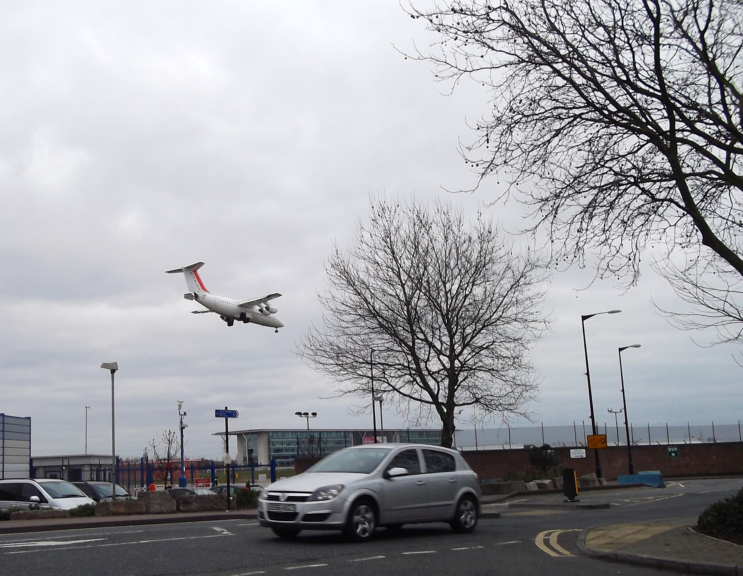 A PLANE LANDING AT CITY AIRPORT
