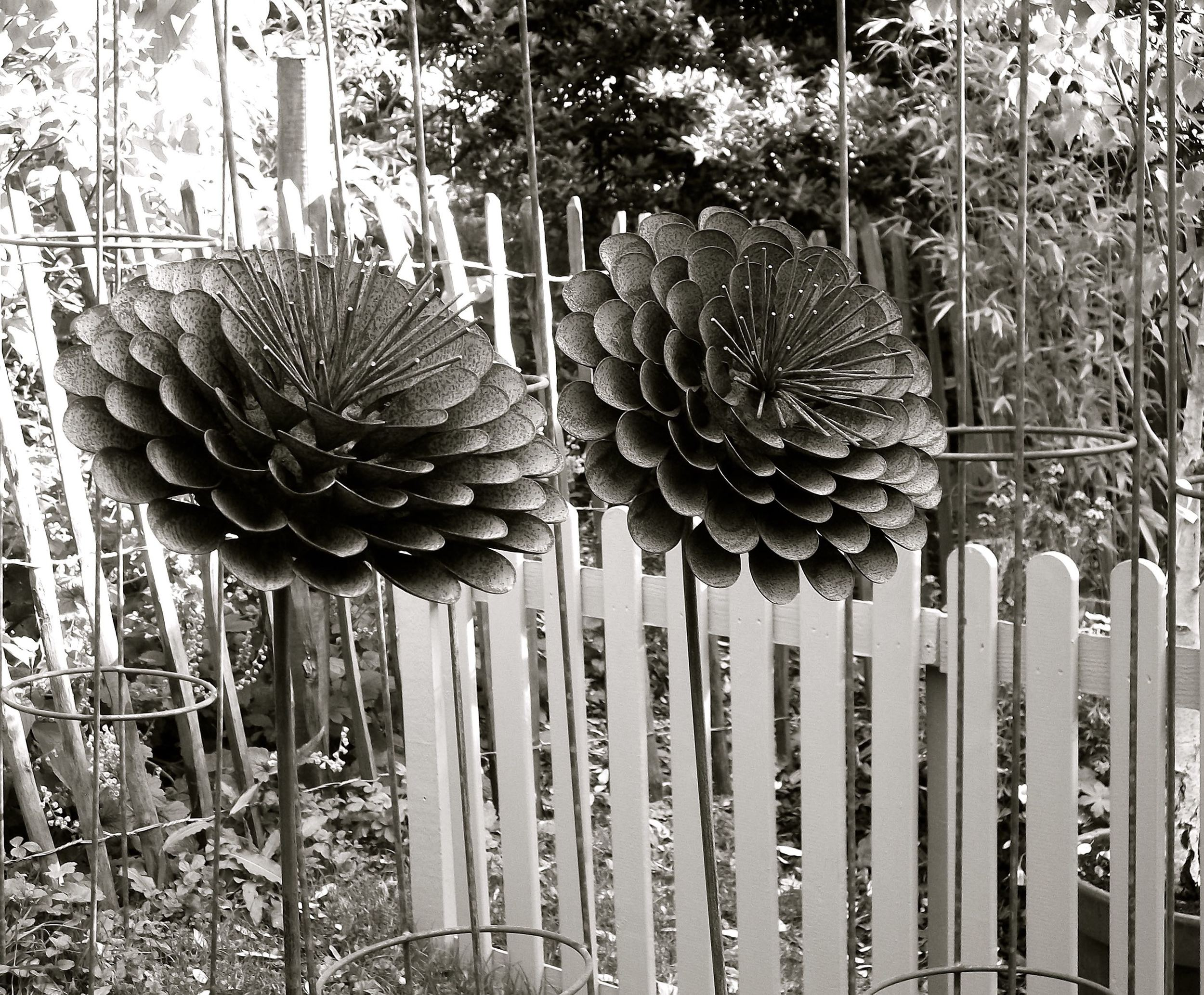 LARGE IRON FLOWER ORNAMENTS
