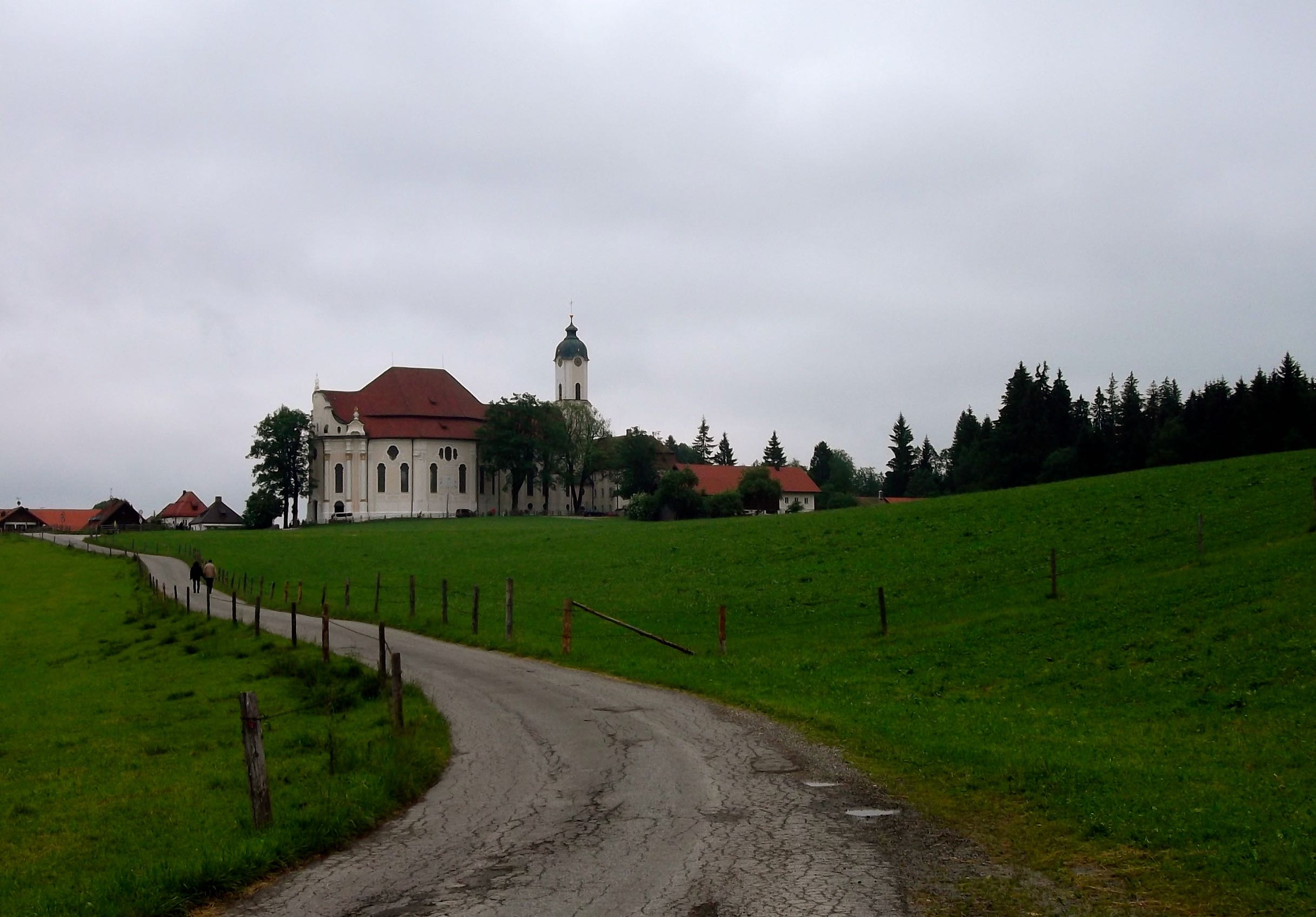 VIEW OF THE WIESKIRCHE EMERGING FROM THE WOODS