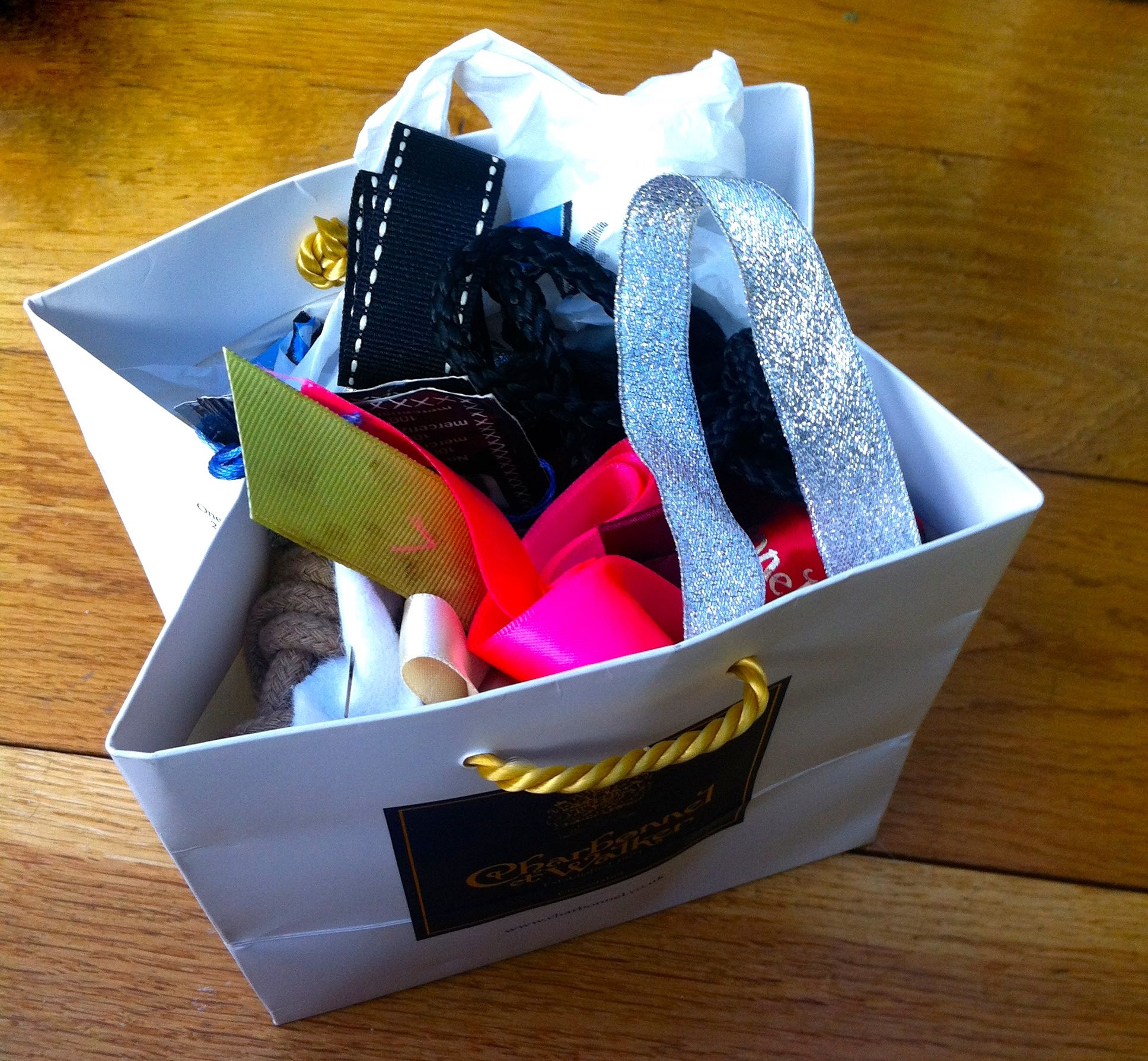 A BAG OF RIBBONS AND CORD