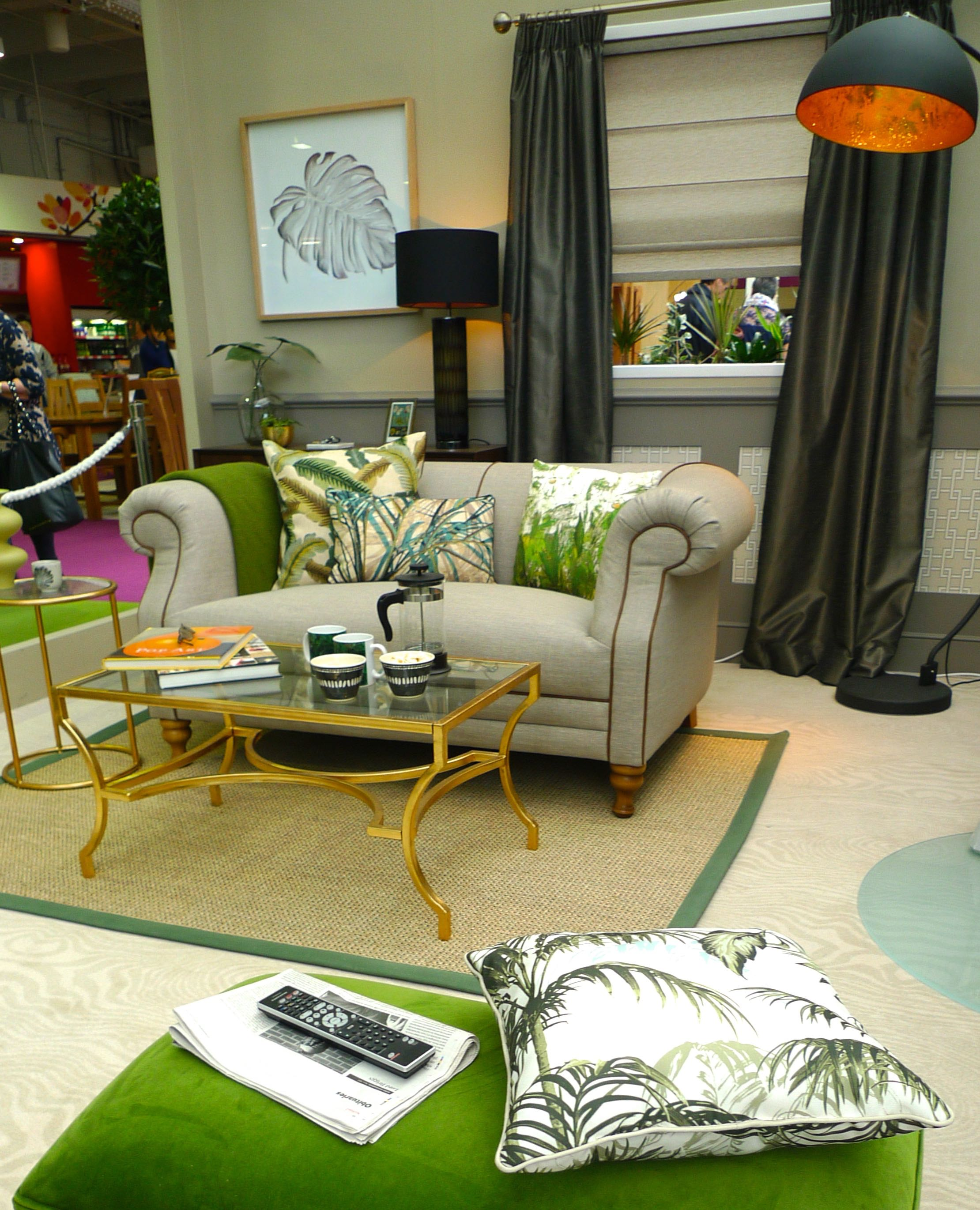 grey sofa and brass tables