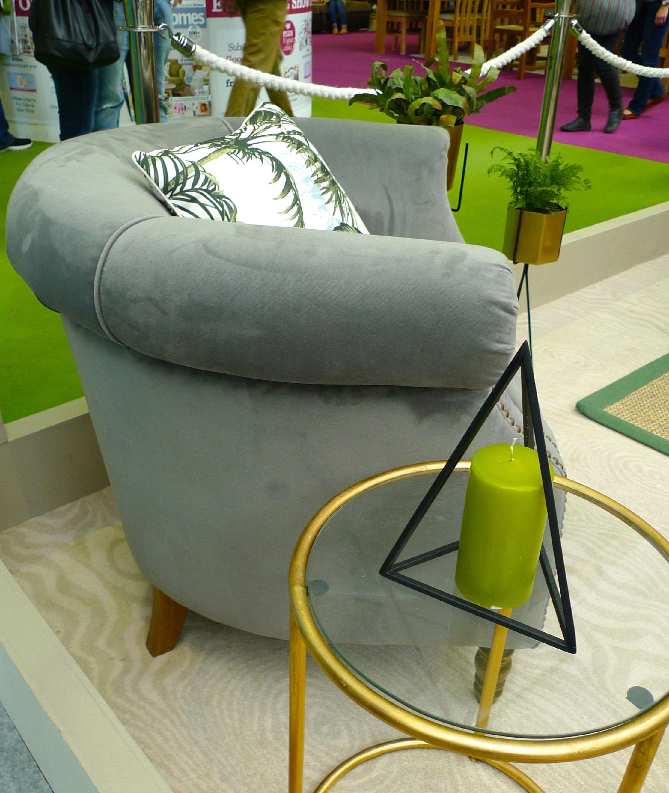 grey tub chair and cushions