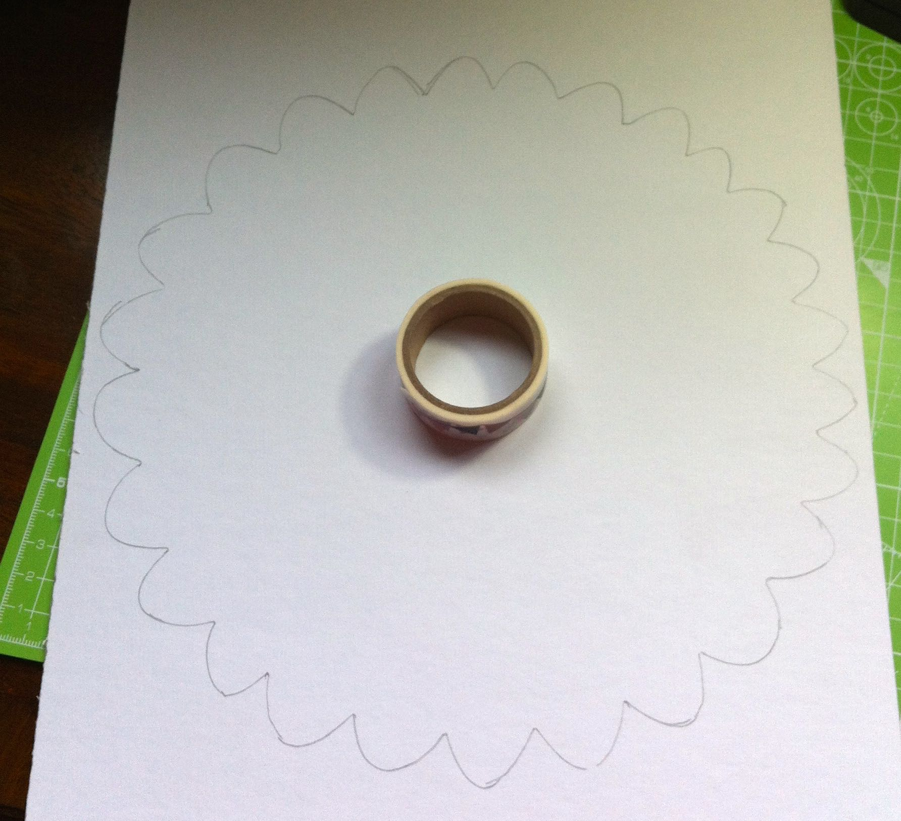 Making a flower shaped template from card and using a roll of washi tape for the centre