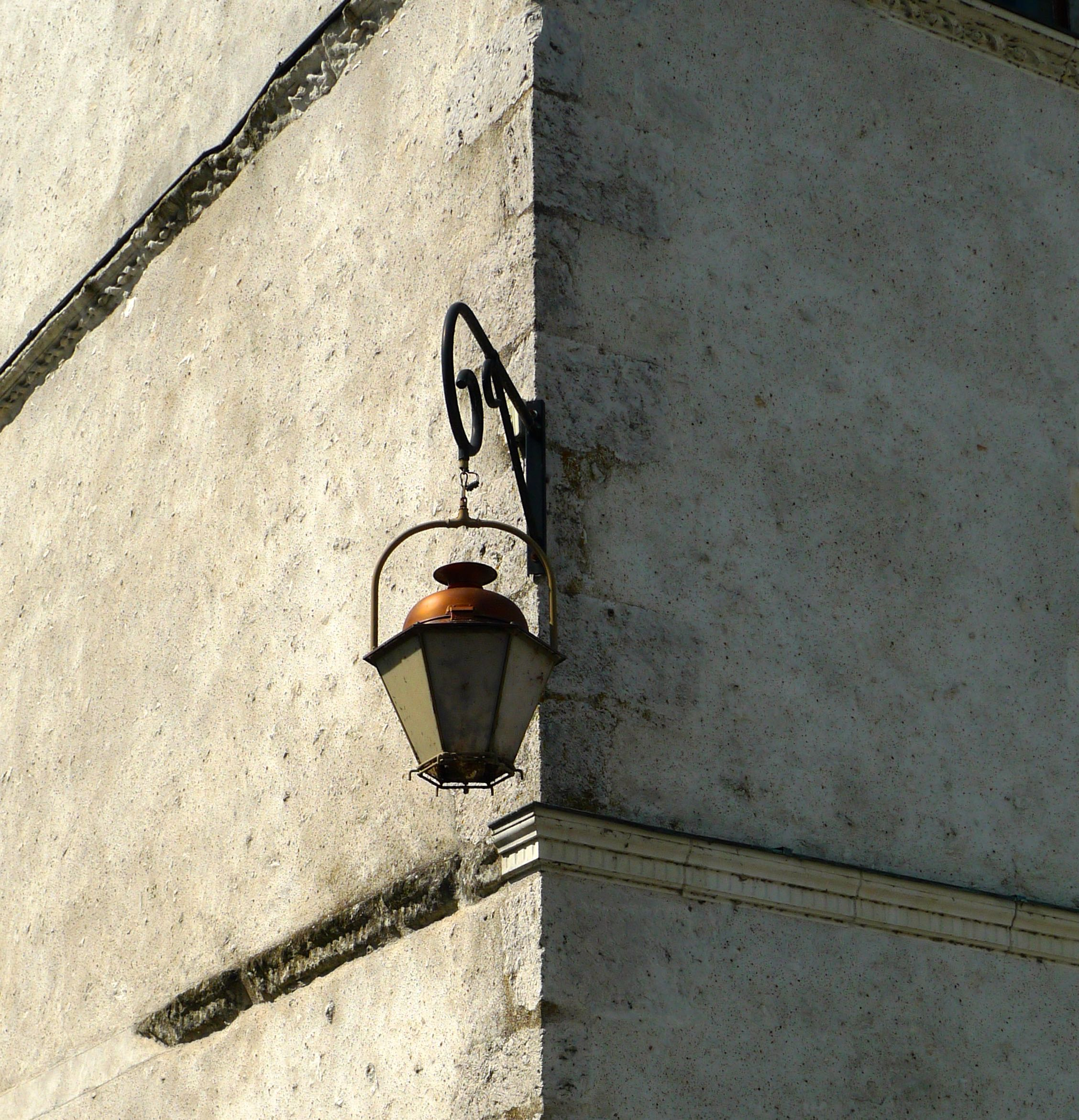 A lantern on the corner of the building