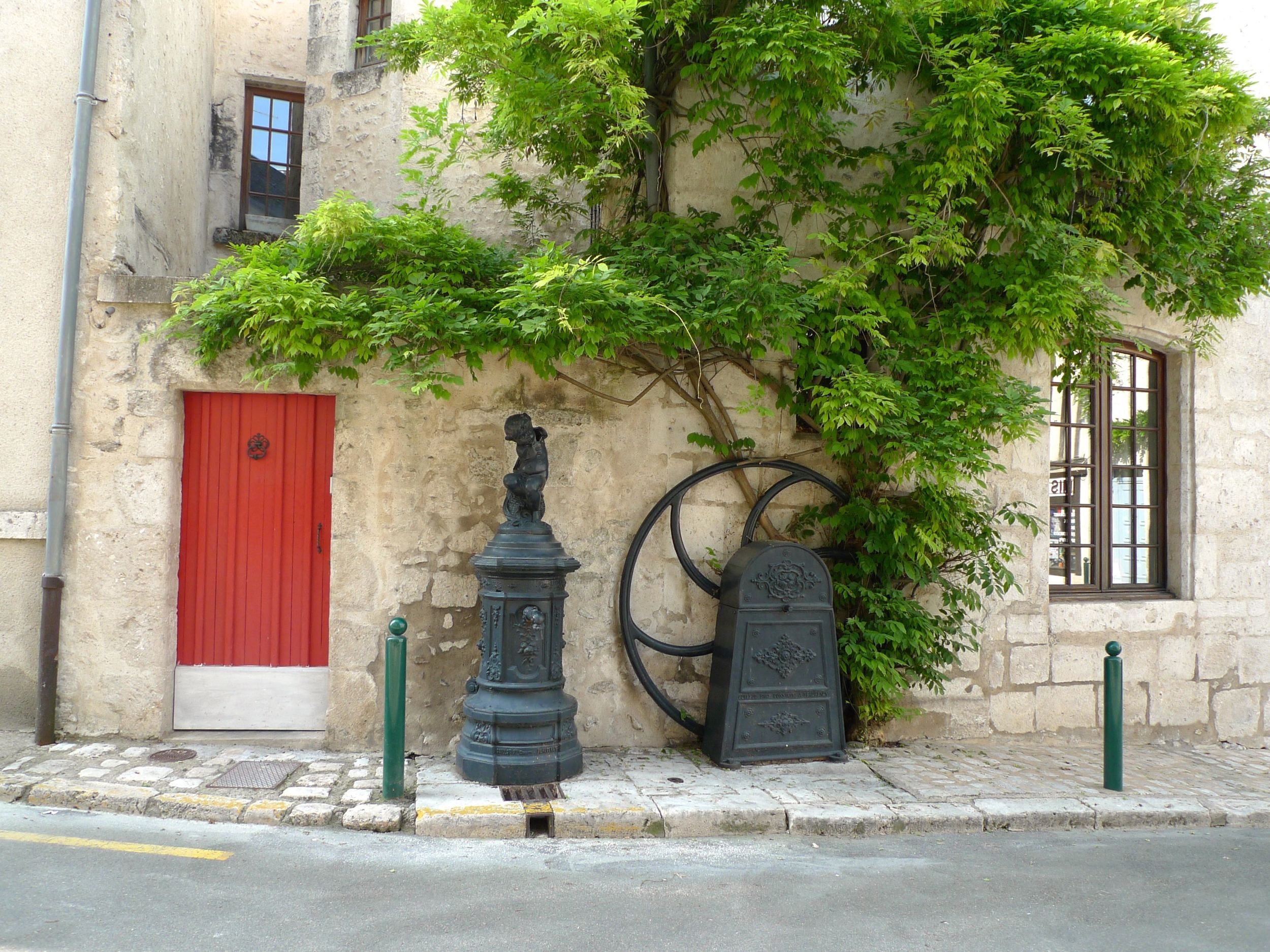 A red door, wisteria and some interesting ironwork