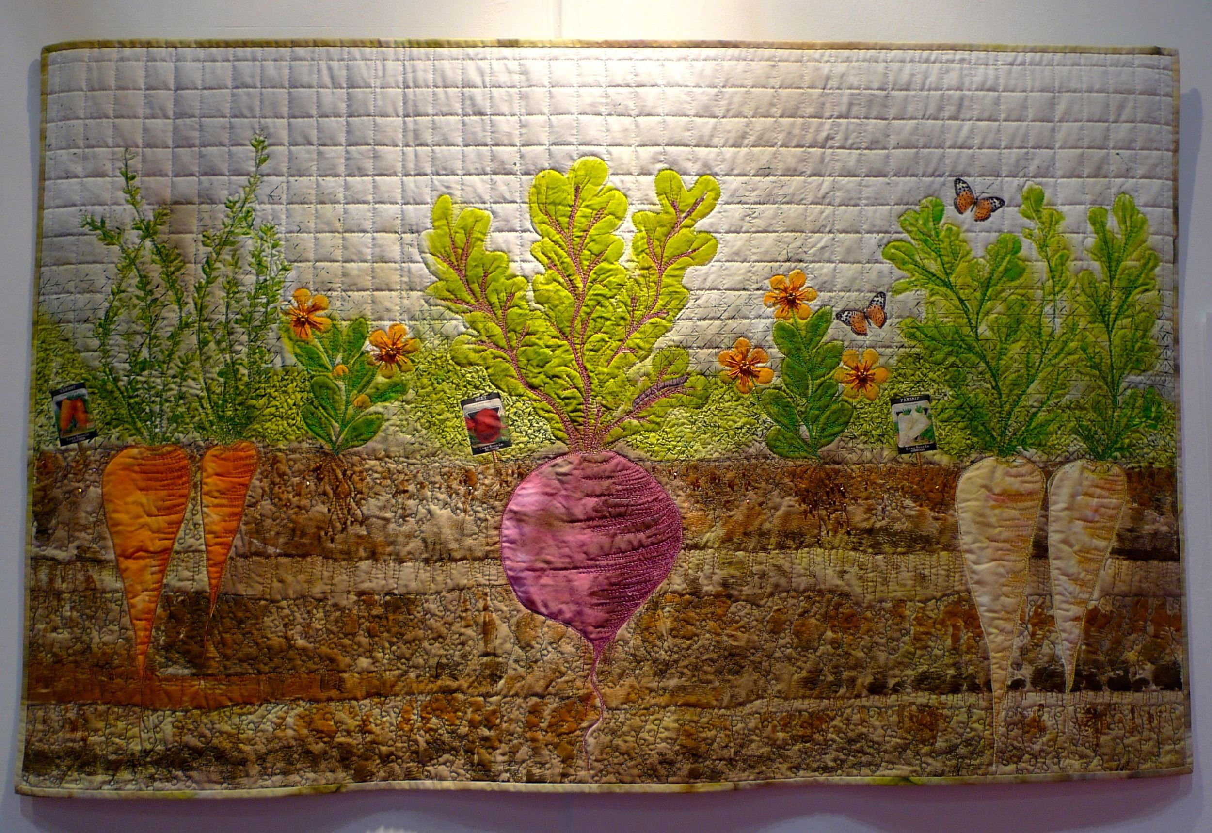 Beetroot, carrots and parsnips on a quilt