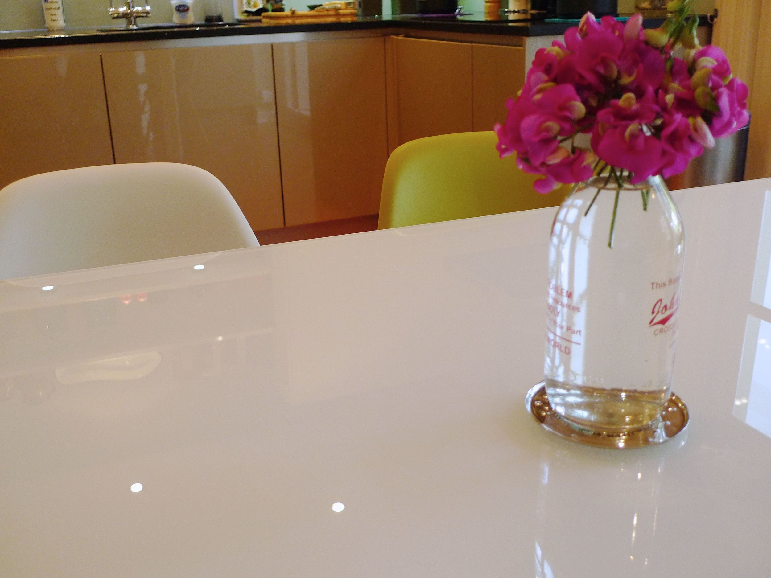 sweet peas, milk bottle and eames chairs