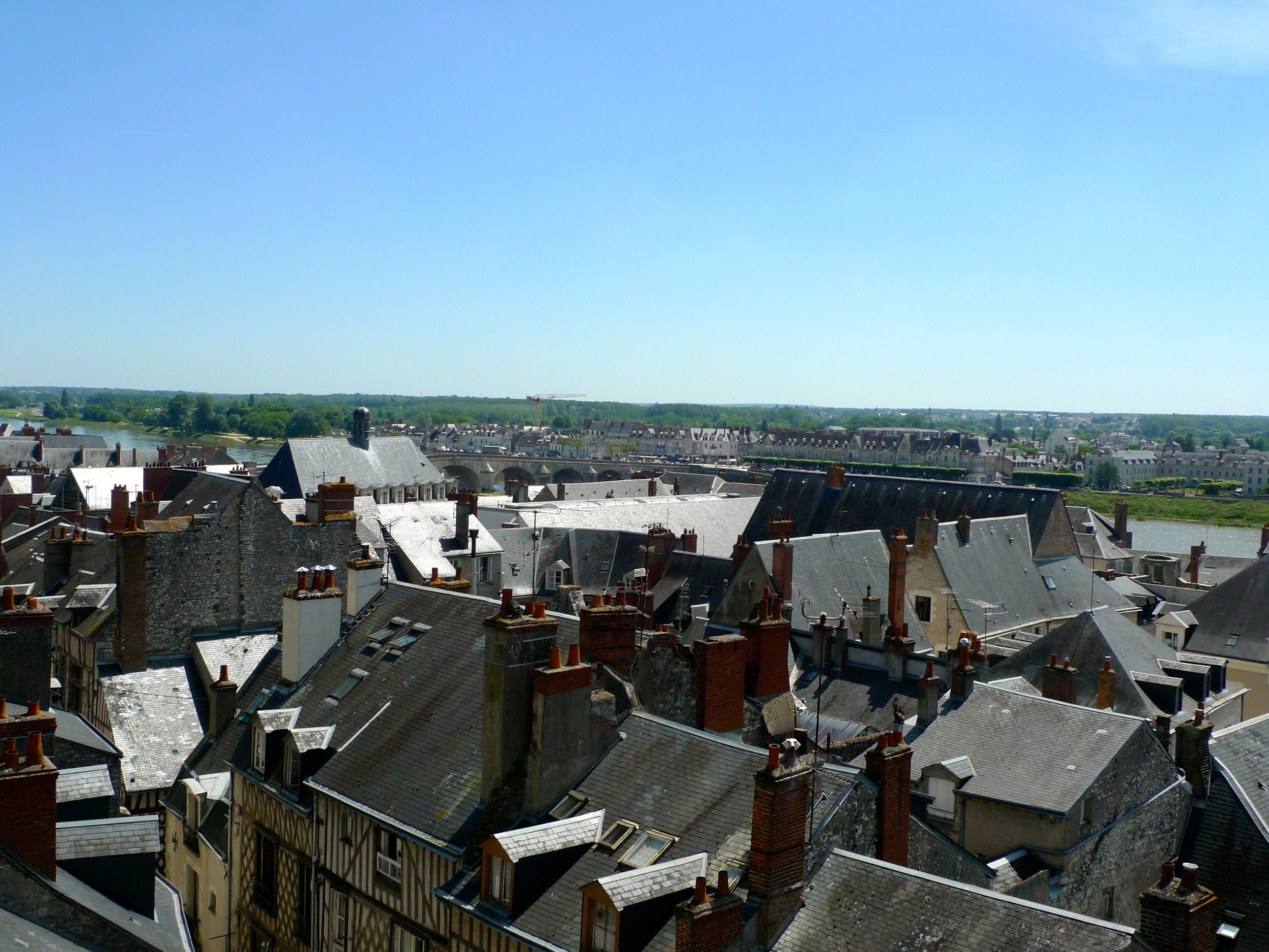 Rooftops in front of and beyond the bridge