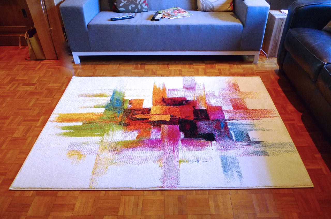 A grey sofa and my new Impressionist rug from My Rug Store