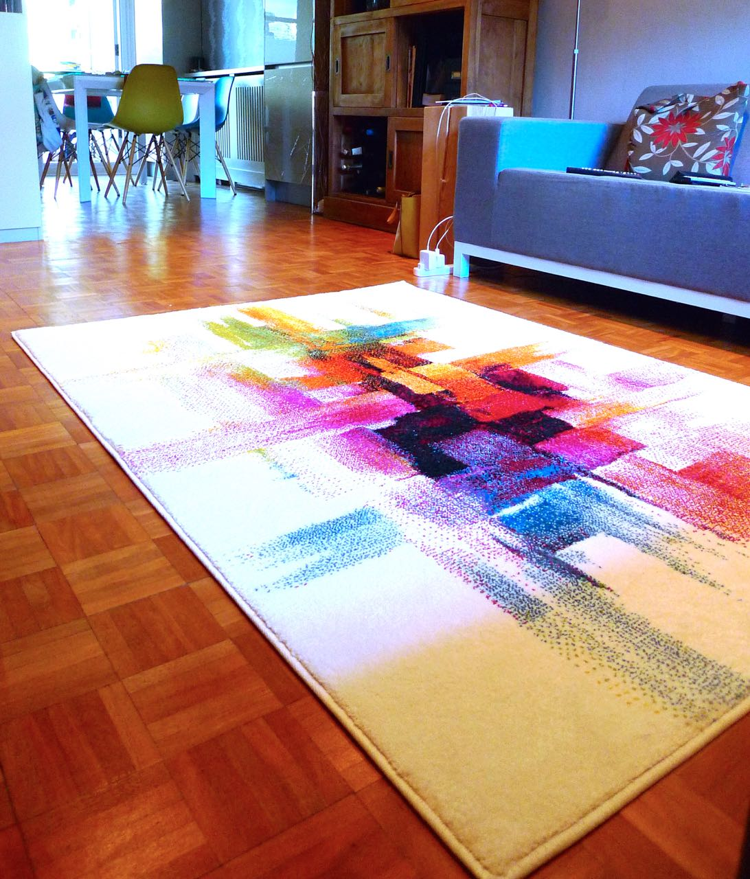 Using the Impressionist rug to tie living spaces together