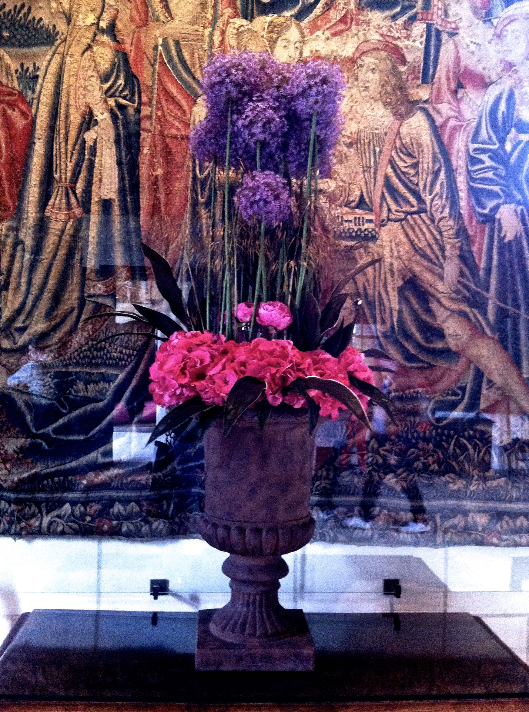 Flowers in front of the tapestry