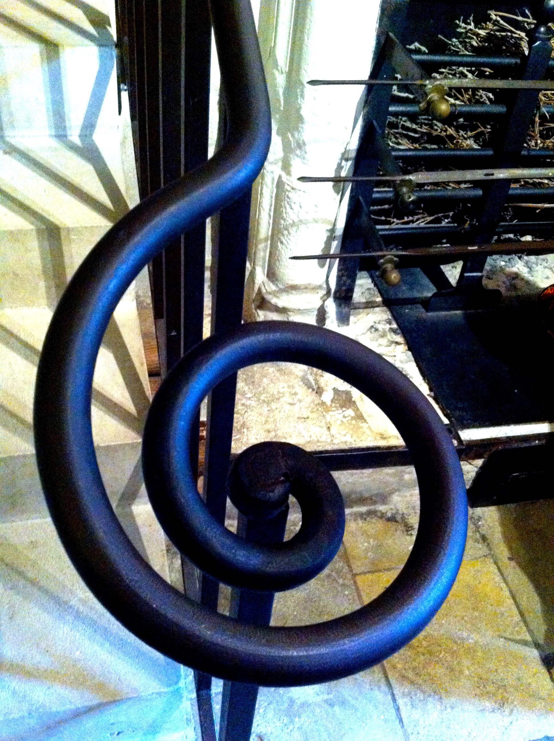 An iron hand rail in the kitchens at chenonceau