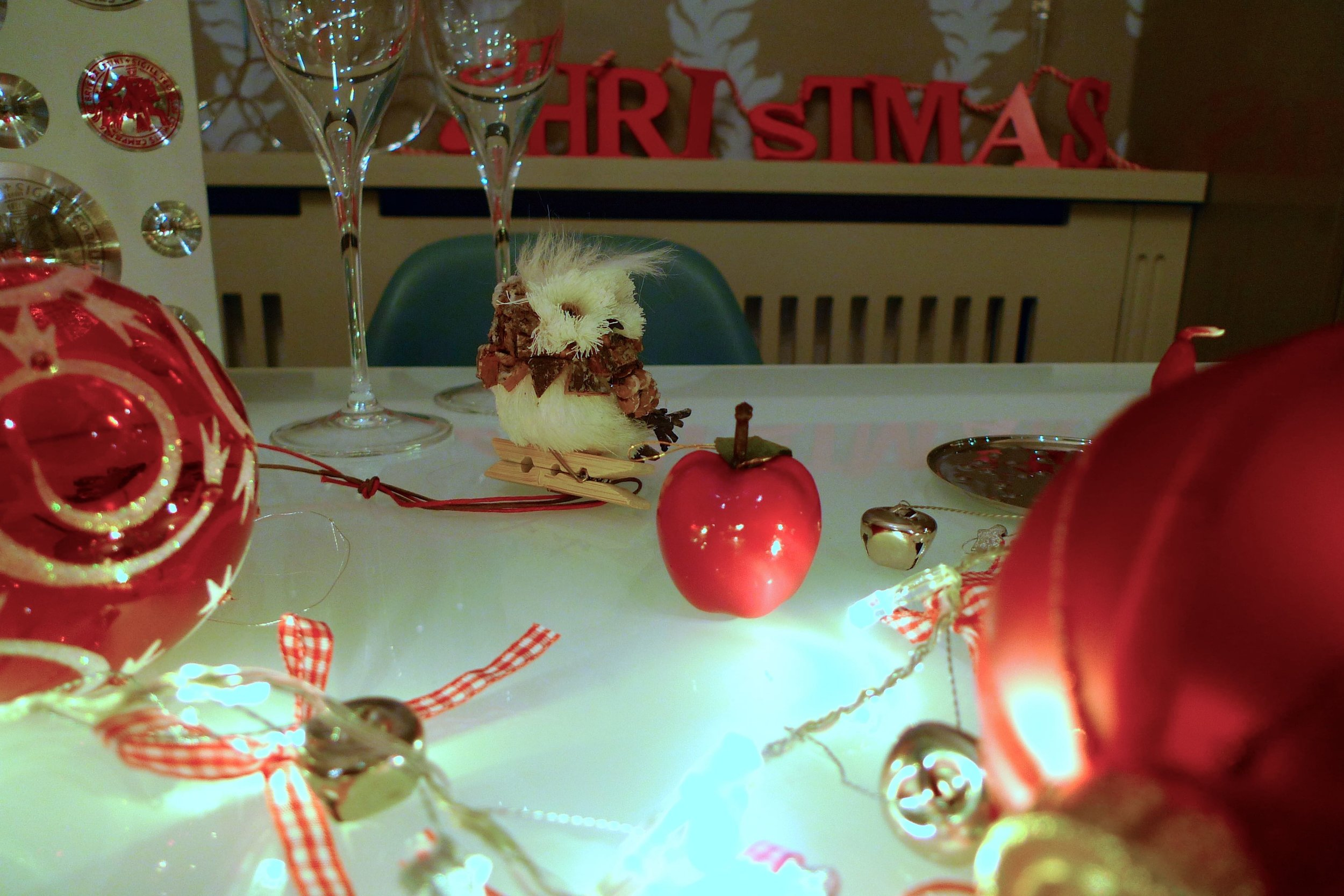 The cheery owl from TK Maxx - one of a pack of three - surveys the decorations on the table