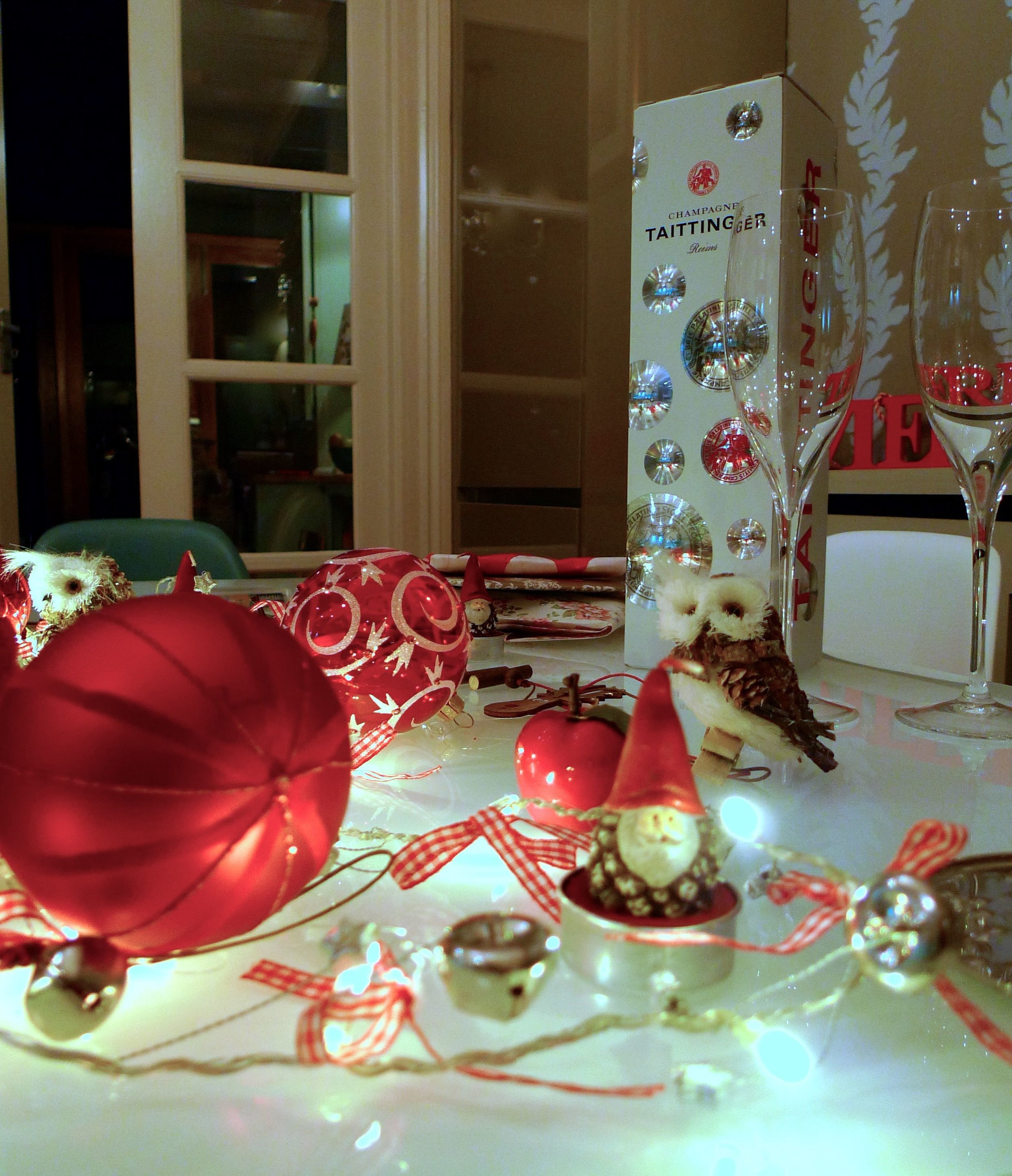 Baubles, bells, owls and tea lights on my christmas table