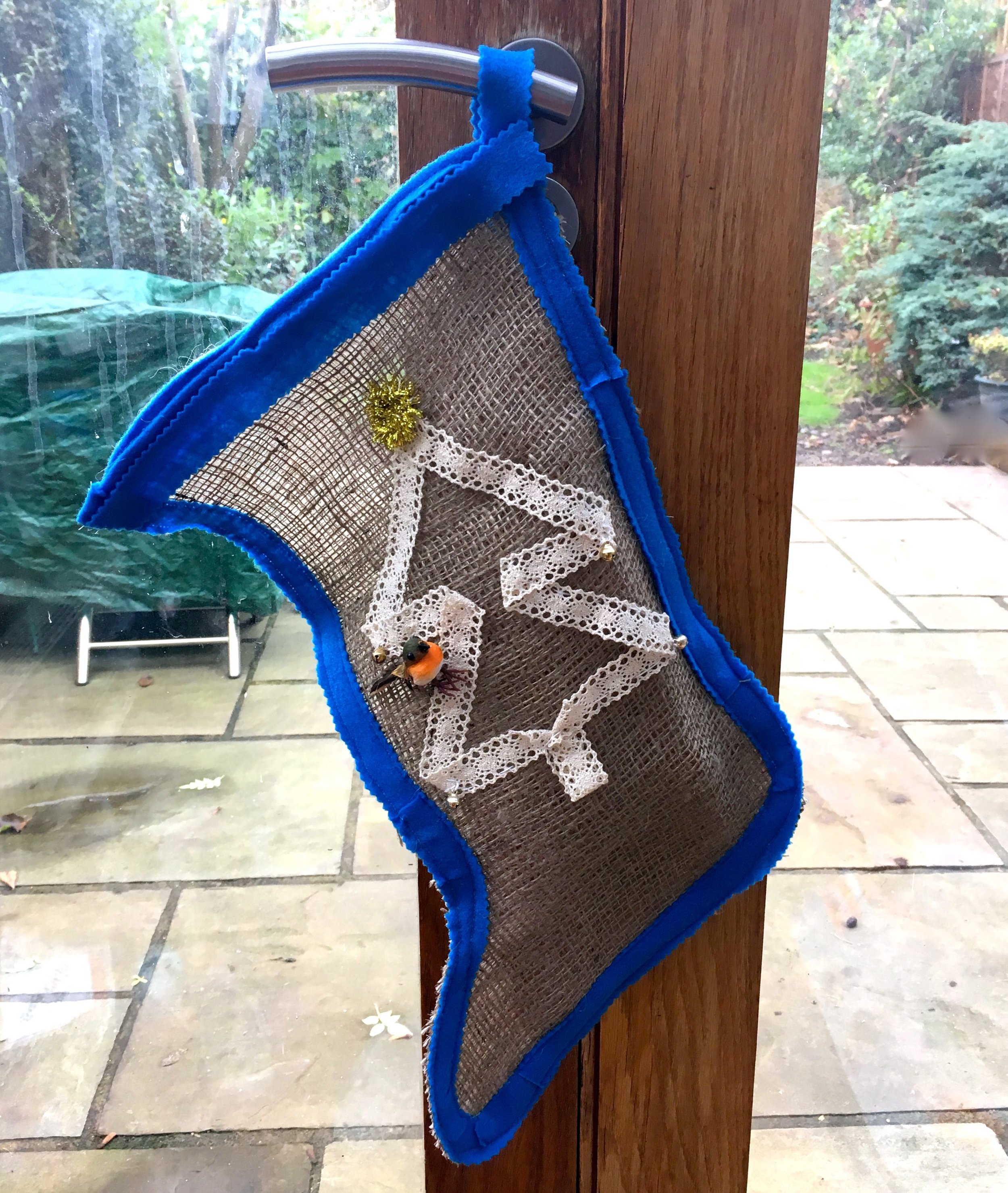 A hessian stocking trimmed with felt and lace