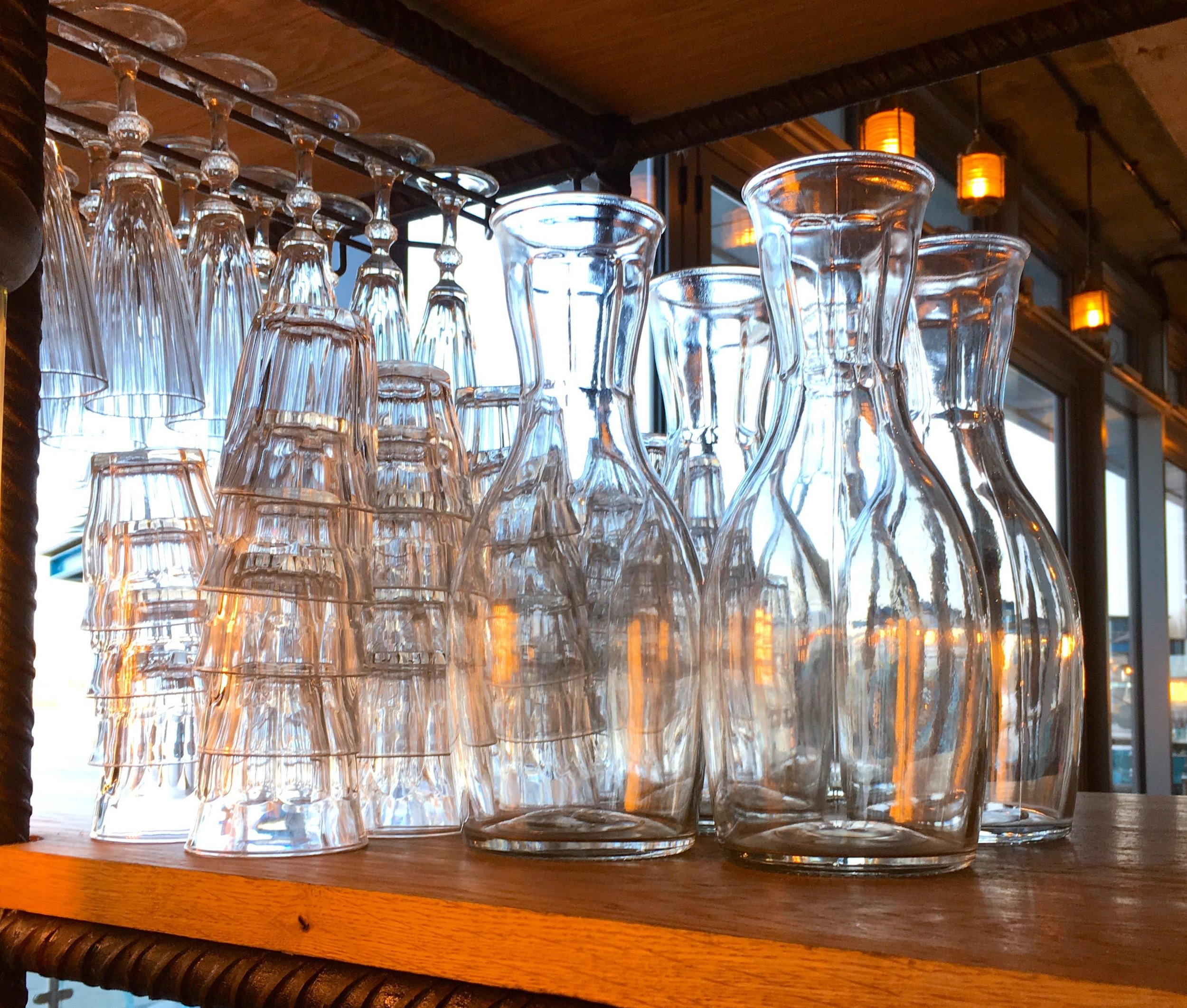 glasses and carafes for water on one of the industrial screen come storage units