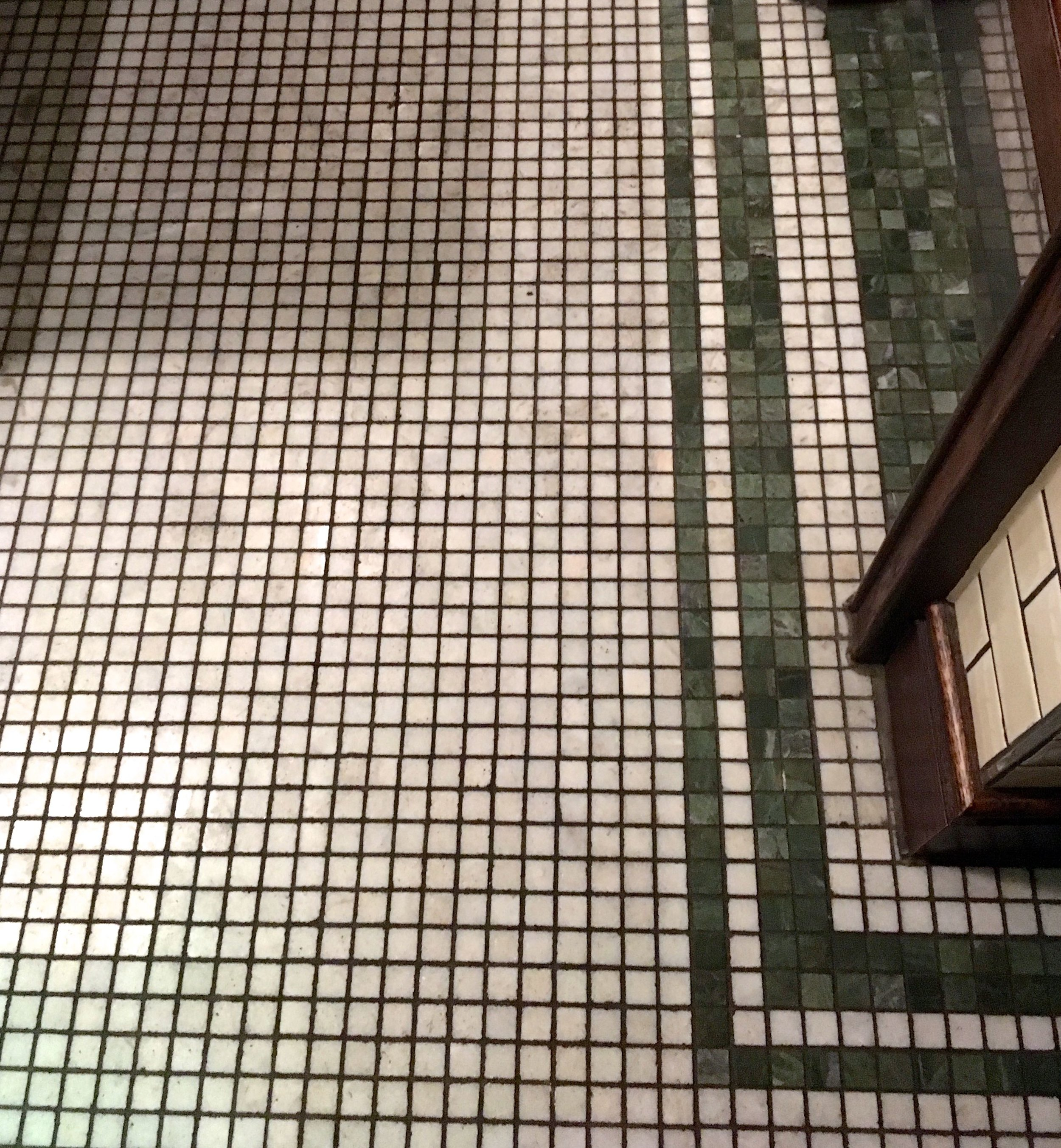 A mosaic tiled floor in the ladies at les deux salons in central london