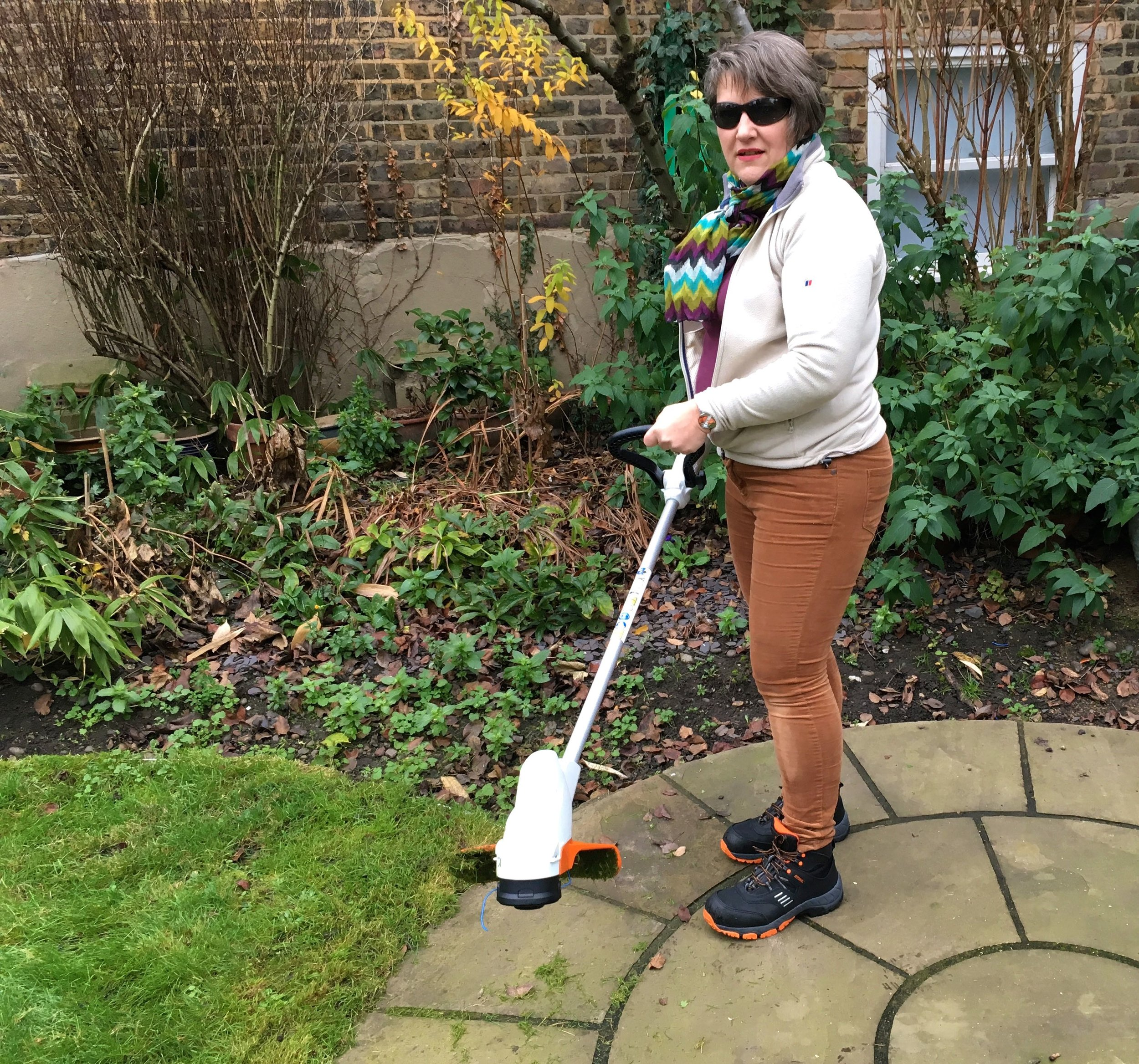Getting to grips with using the Stihl compact trimmer, when I 'wrestled' it from MOH