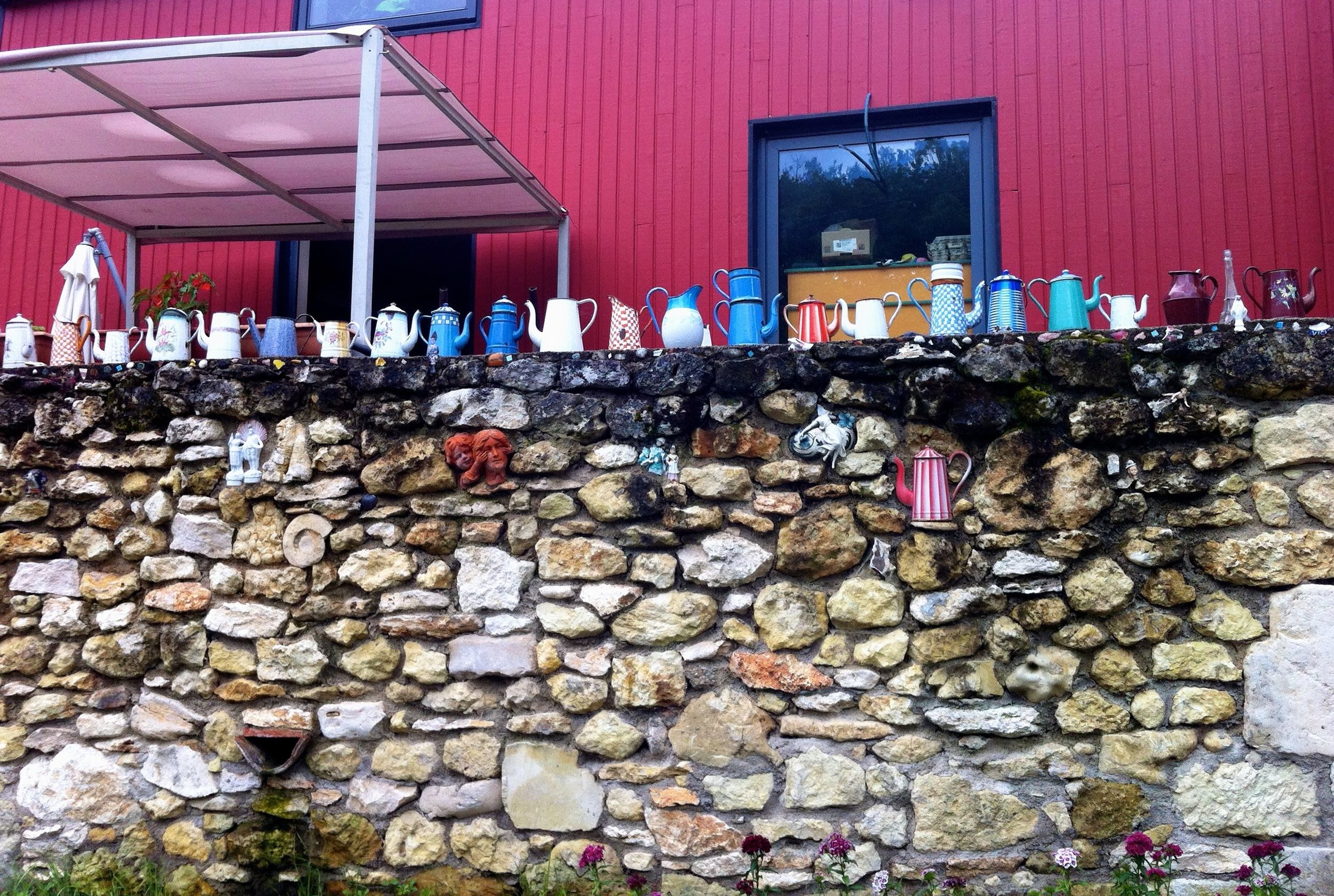It was only when I was close up that I recognised the colourful additions as coffee pots, each and every one of them