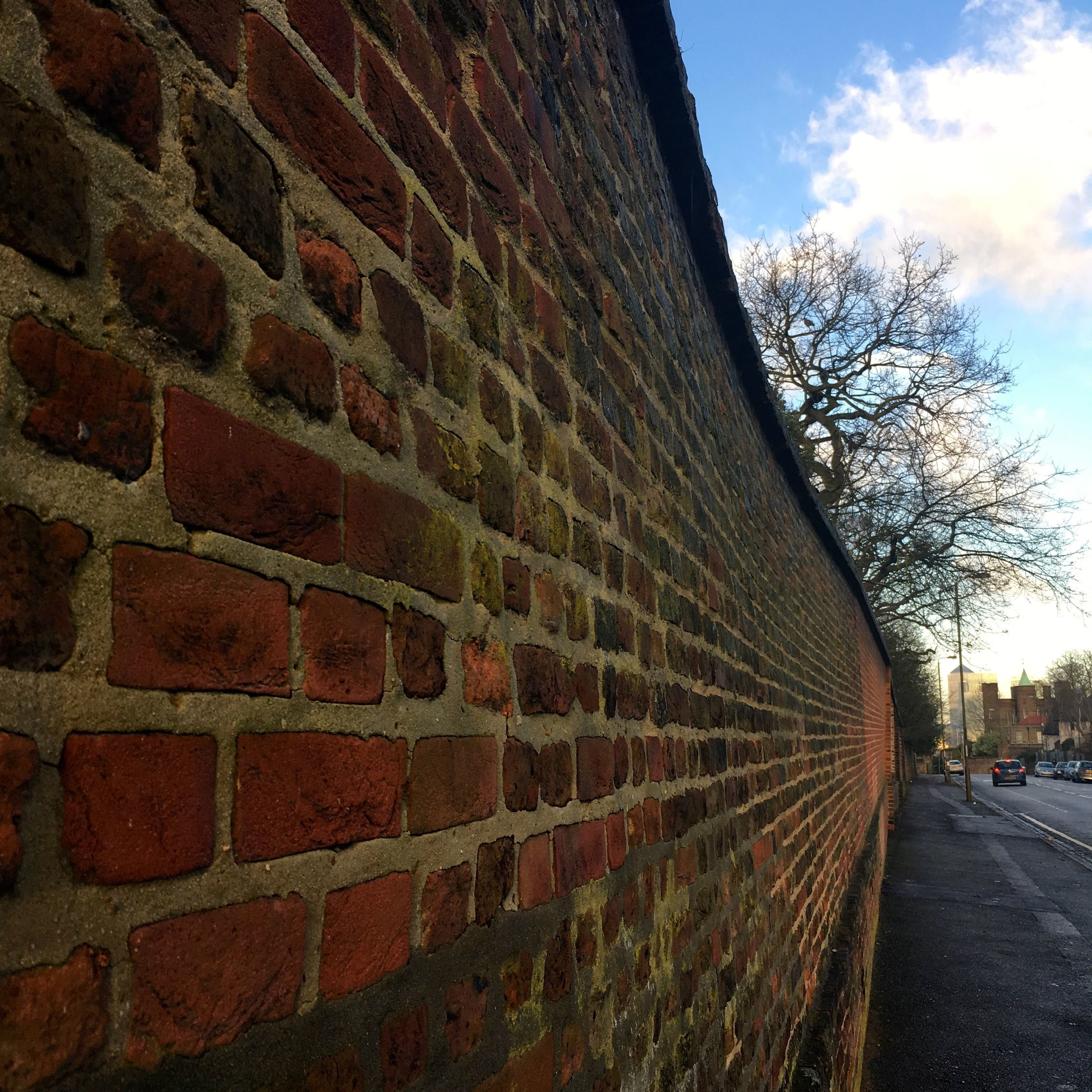 The brick wall boundary from outside Greenwich Park