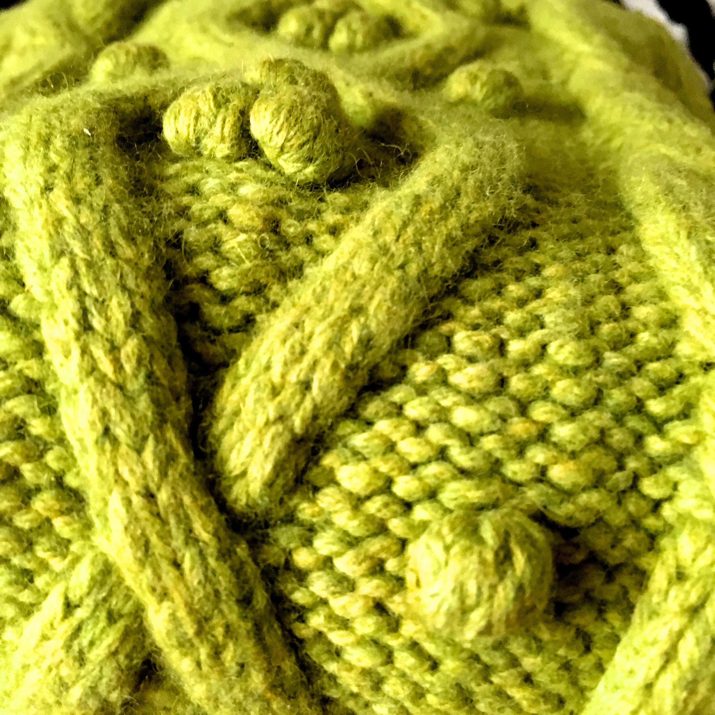 A great big woolly scarf, lime green of course