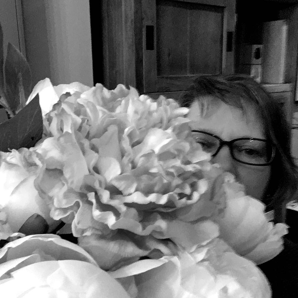 Peering out from behind the faux flowers Valentines bouquet from Homesense