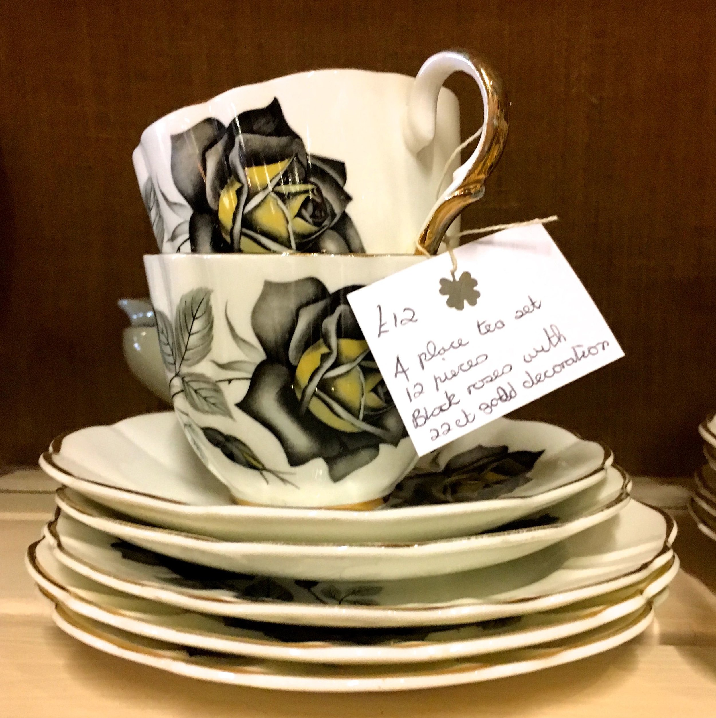 A stack of china with a black rose
