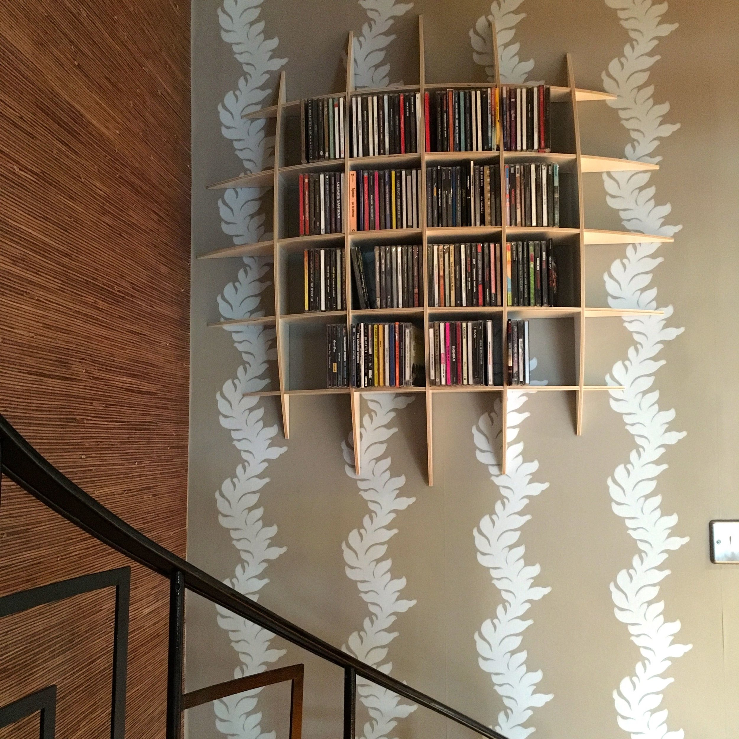 An unusual round shaped CD rack in the otherwise wasted space of our spiral staircase adds interest as well as texture #notcompletewithout