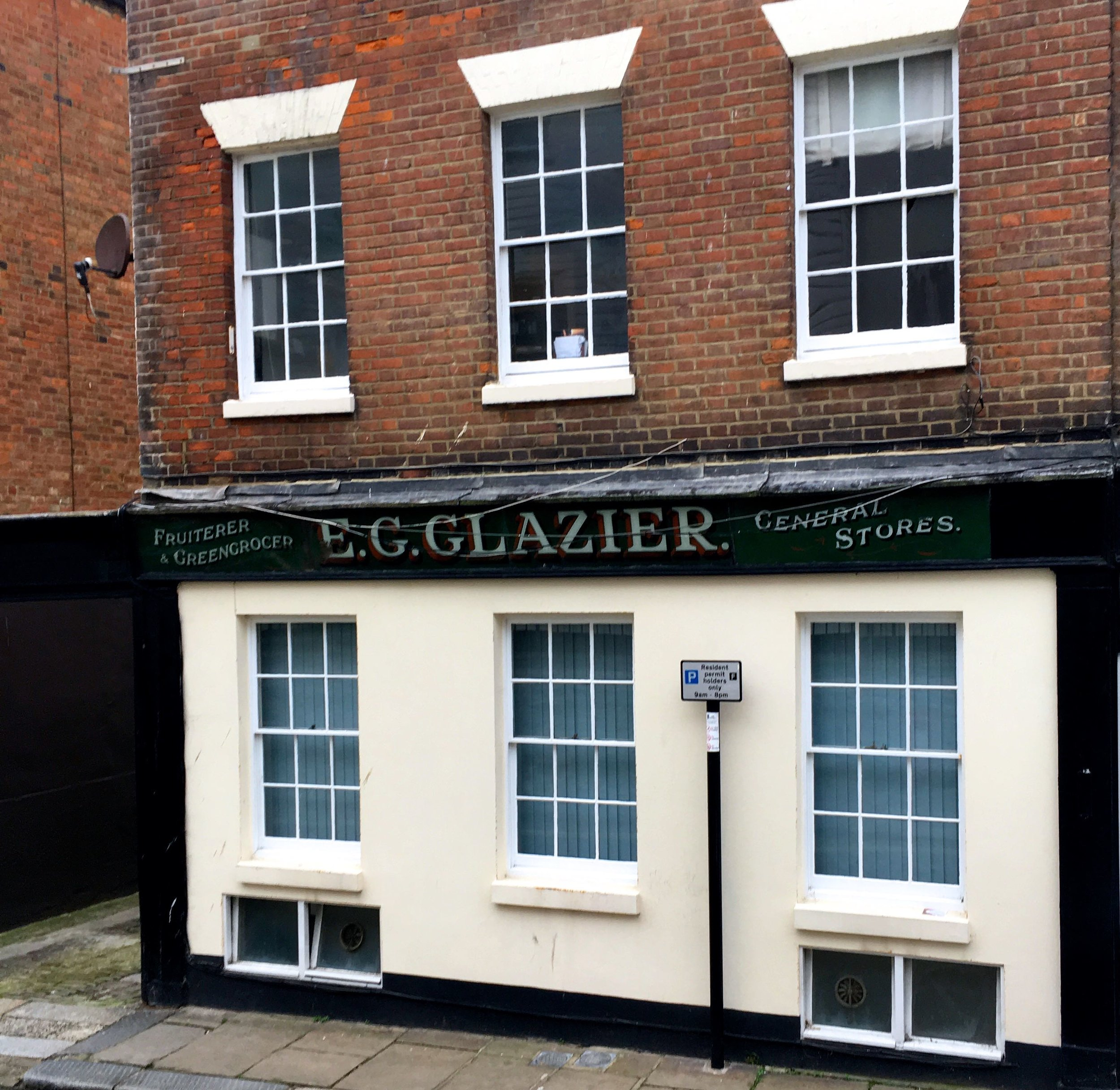 A traditional shop sign kept even though the building has been transformed