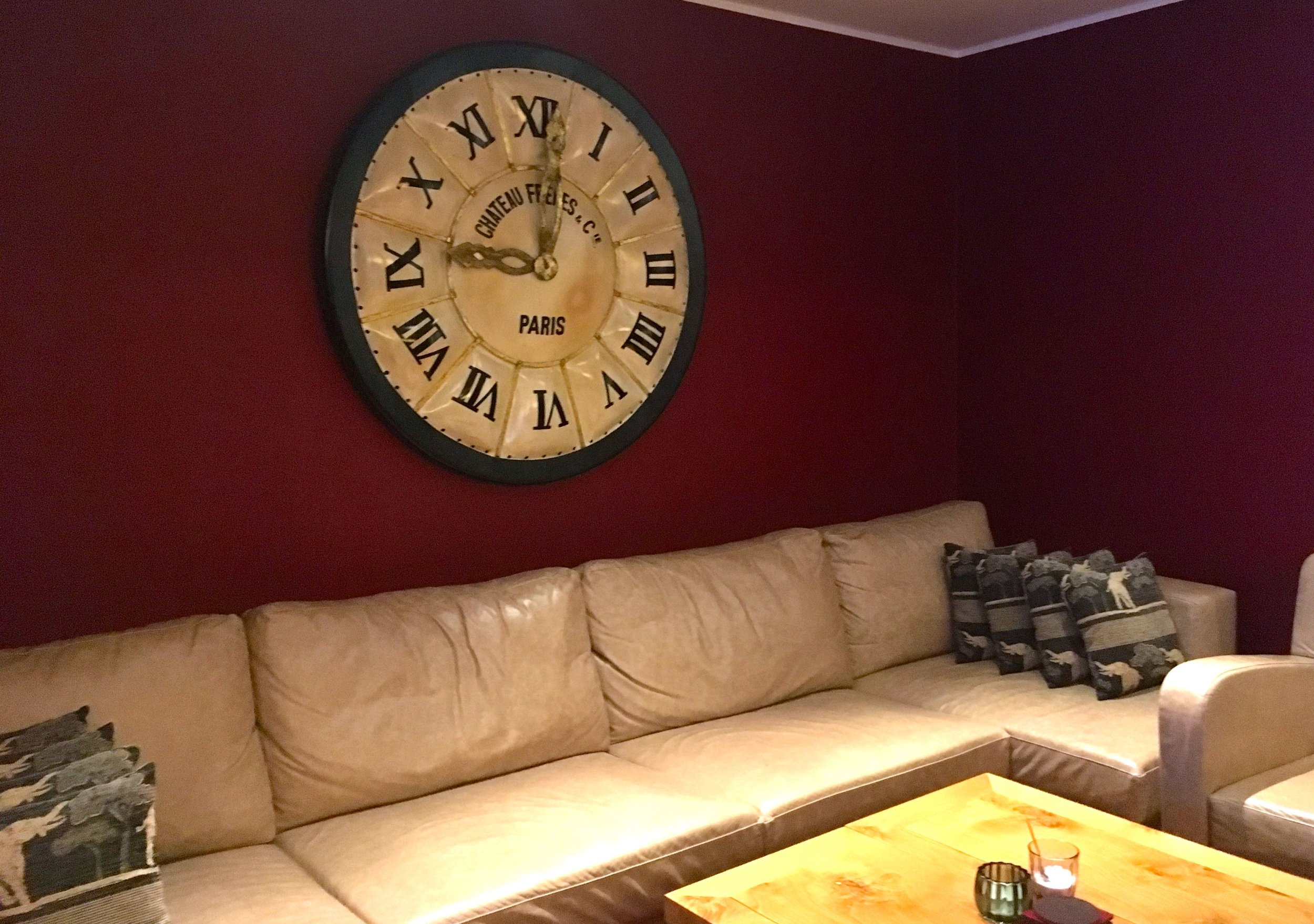 Comfy sofas and an oversized clock in one part of the hotel bar
