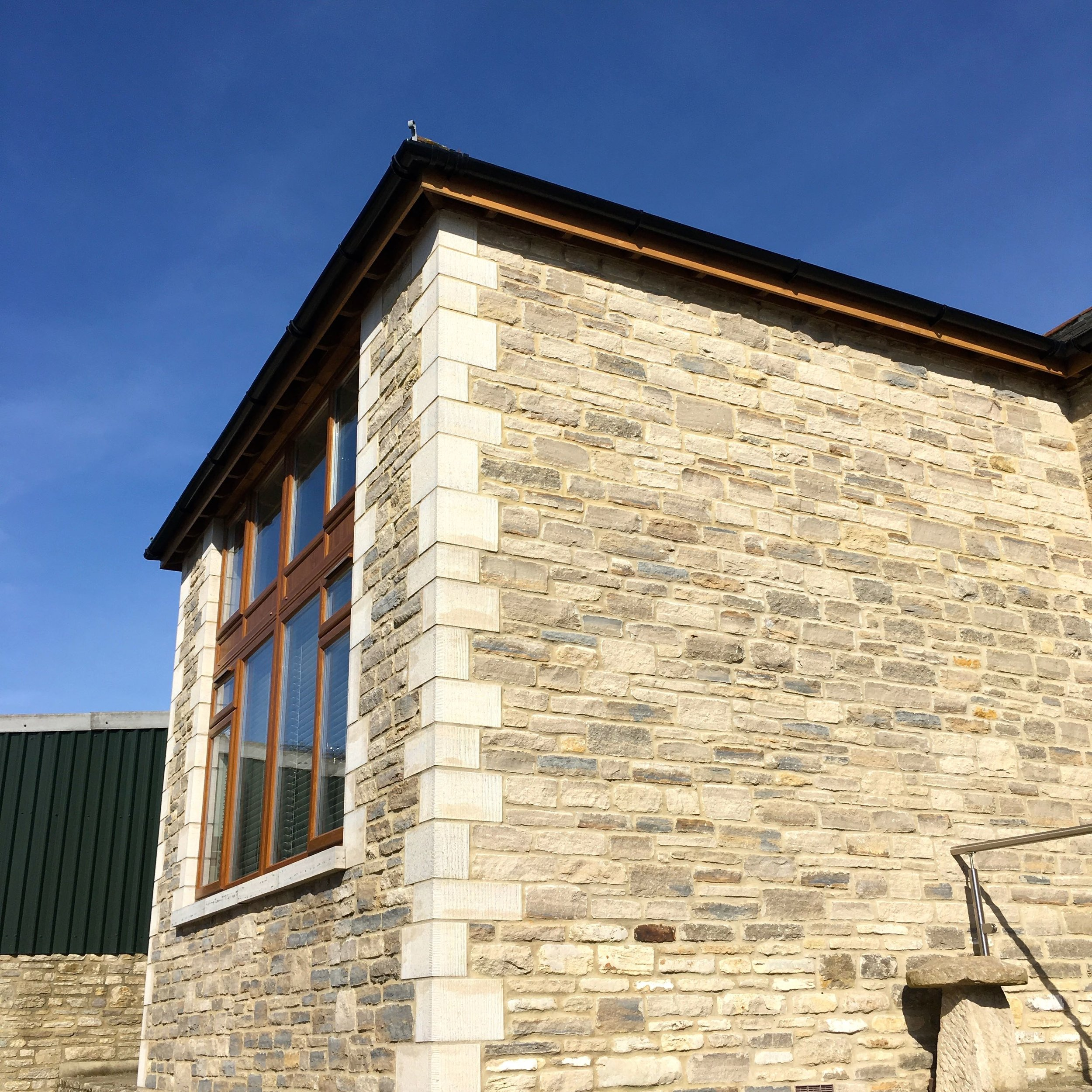 blue skies and the Old Barn near Swanage