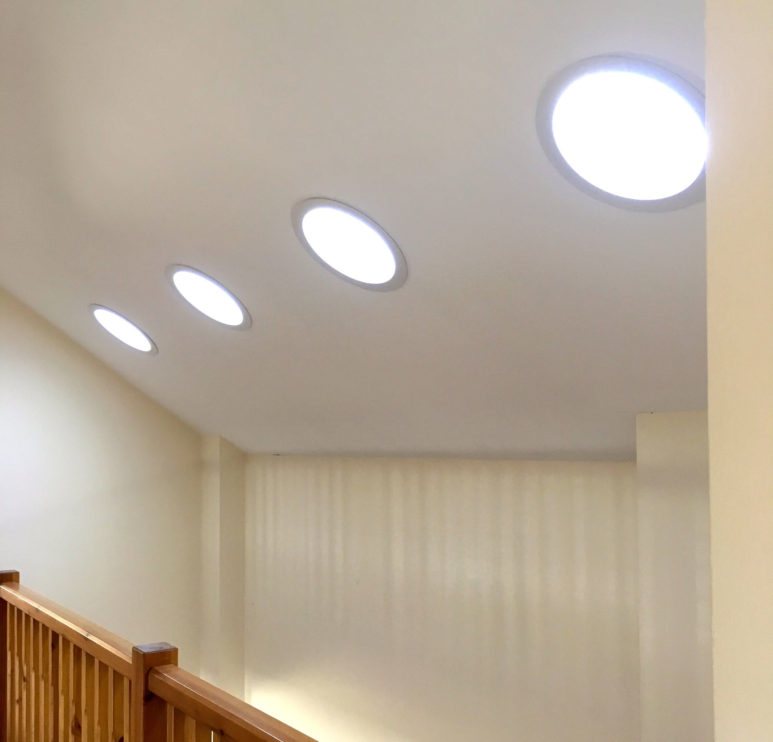 sky lights shedding light into the dining area and the galleried landing