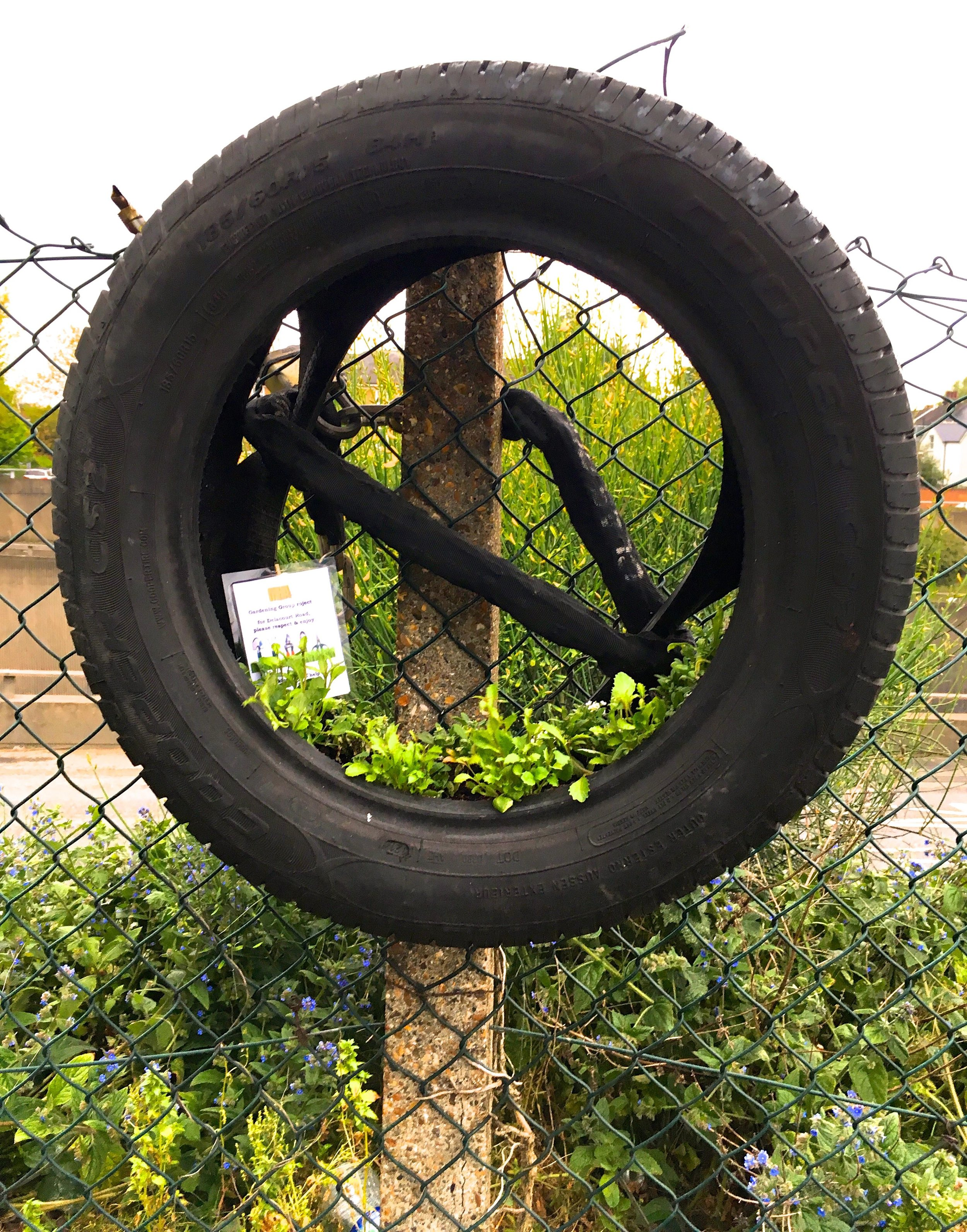 A DECORATIVE TYRE as part of the Delacourt Road Gardening Group Project in Blackheath South London