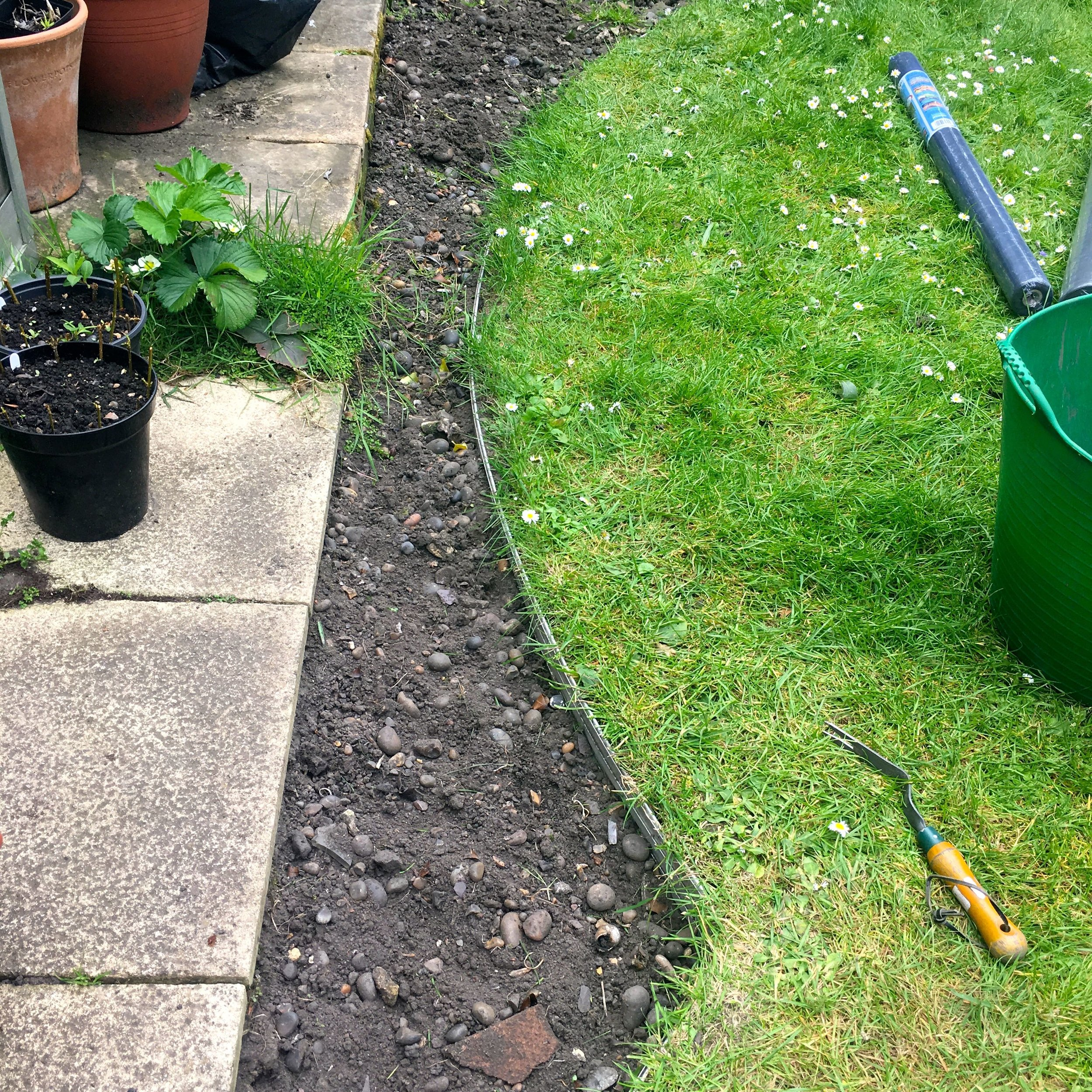 Circles dug and edged, now for the slate