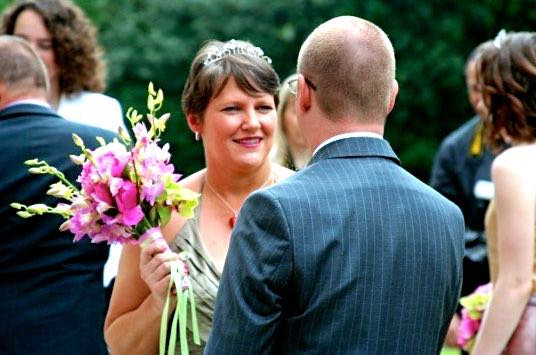 Despite what it looks like I didn't clock my new husband with my bouquet.jpg