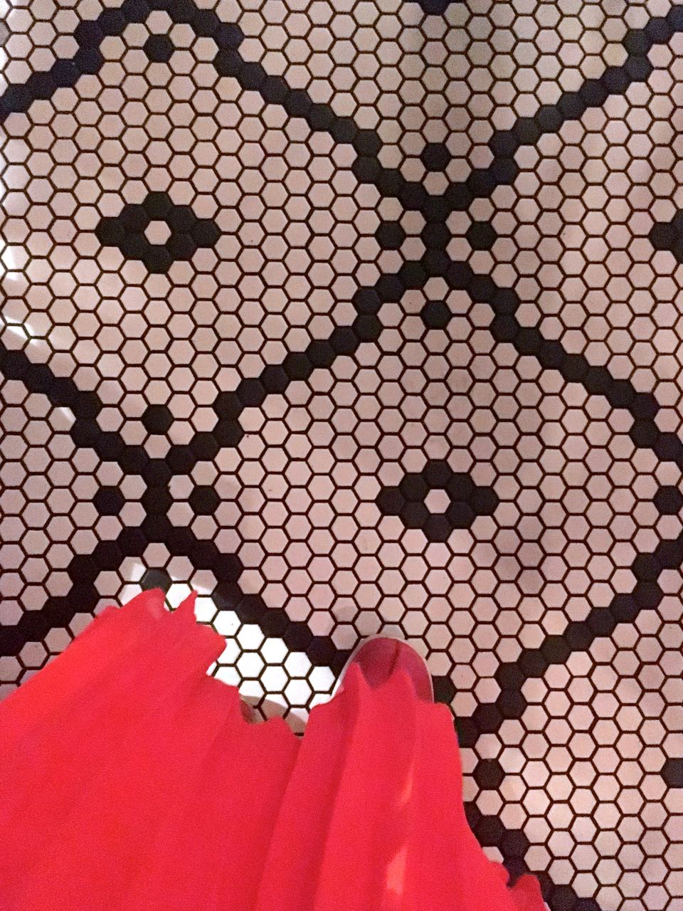 a pleated skirt and the most tradiitonal of tiled floors at the tandoor chop house