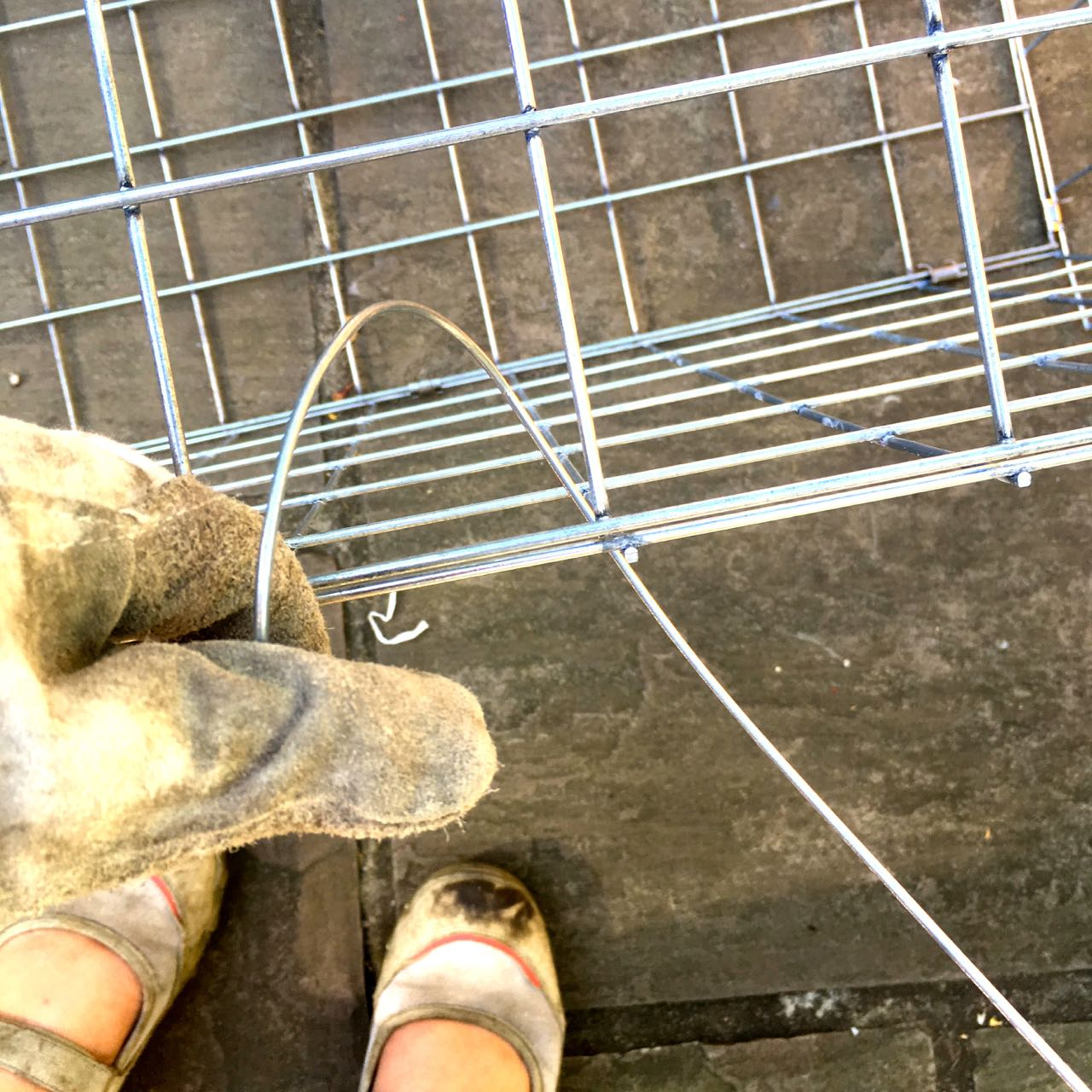 Assembling the gabion baskets was akin to sewing with wire - and with gloves on!