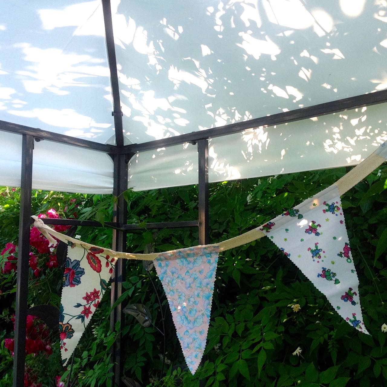 homemade bunting from scraps hanging in the gazebo