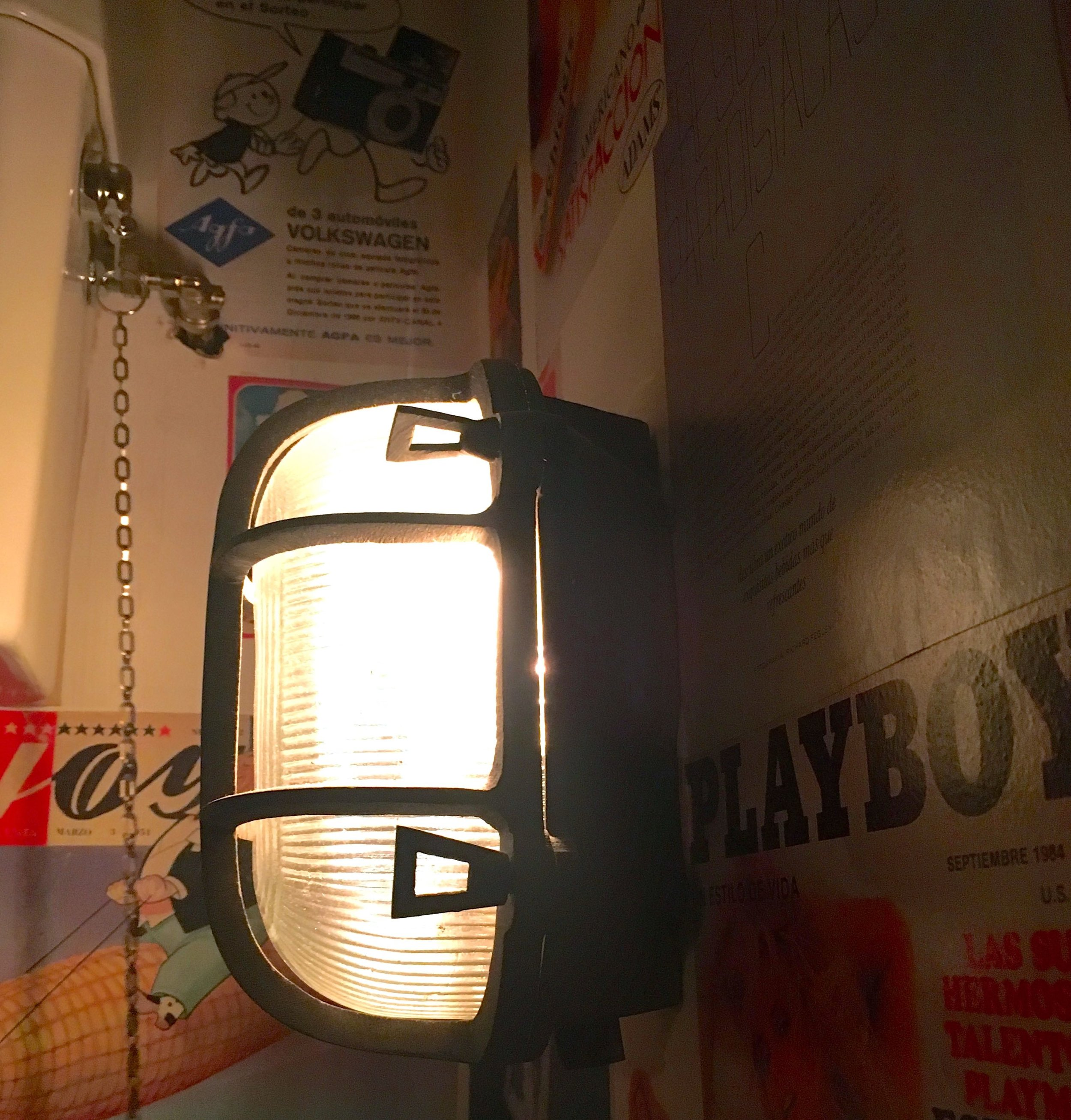 Industrial lighting and magazine covers in the El Pastor loos at Borough Market