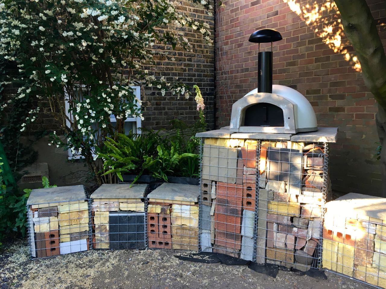 Our pizza oven on top of the gabion baskets