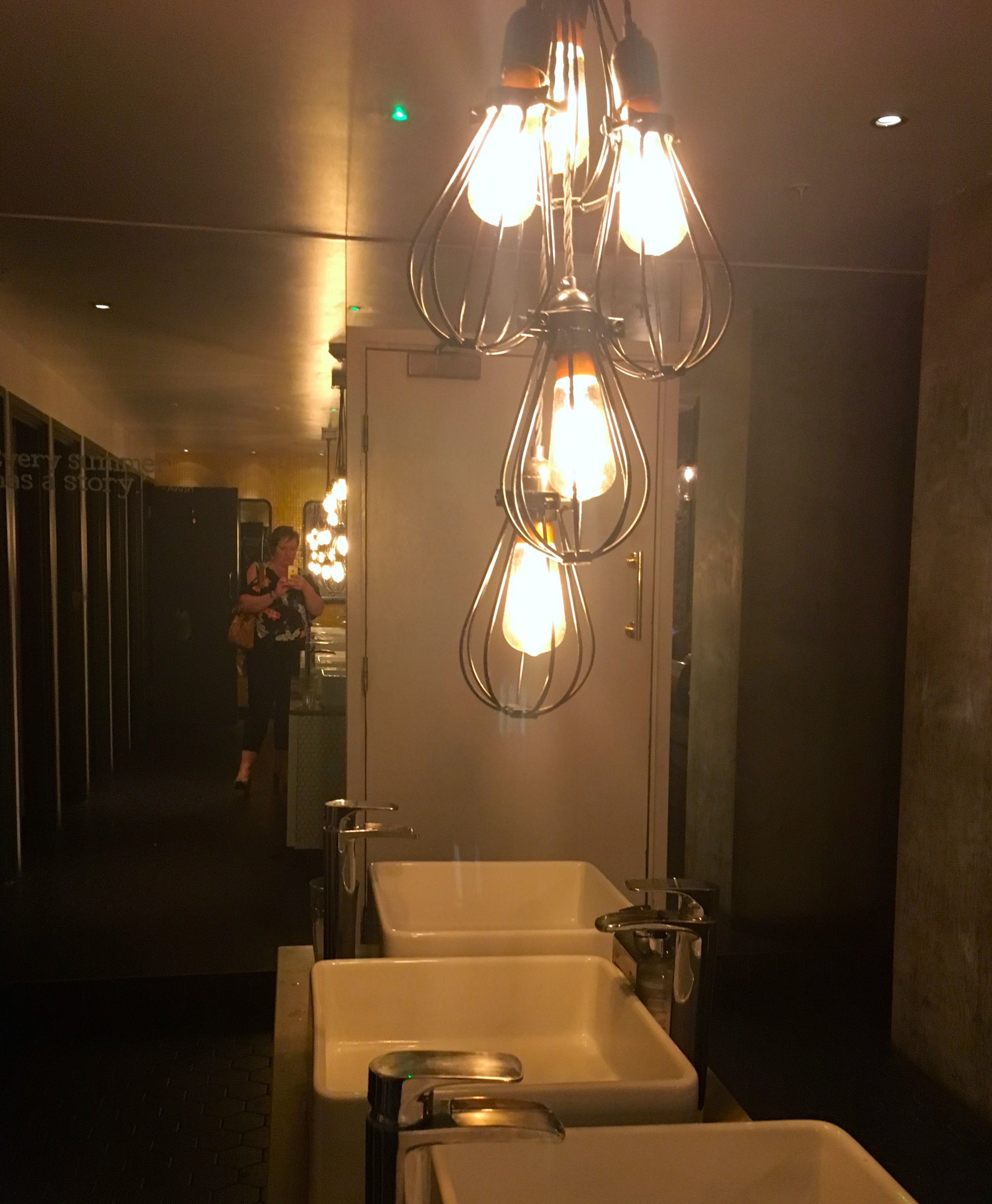 Hanging individual light fittings in the loos at the Anthologist in the City of London