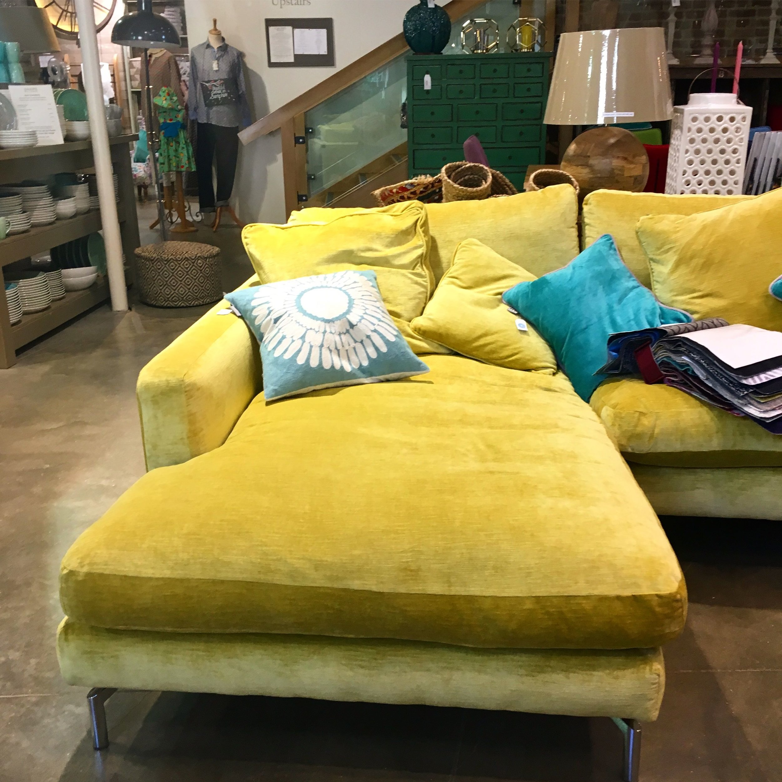 The most delightful yellow velvet sofa in the Homes & Gardens shop at Snape Malting Suffolk