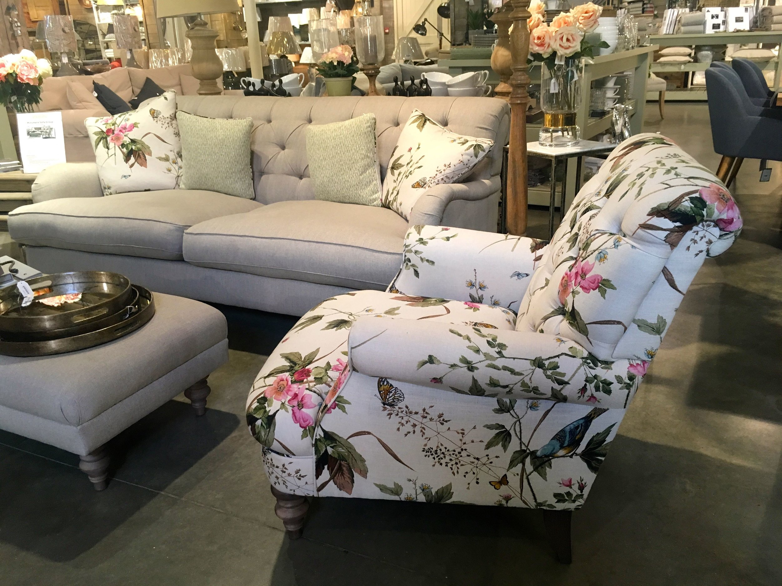 A rose patterned armchair in the Homes & Gardens shop at Snape Malting Suffolk
